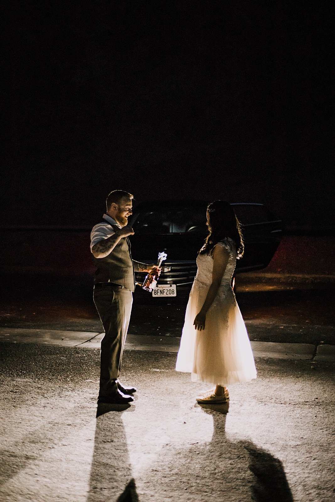 popping champagne to toast, death valley national park elopement, elope in death valley, badwater basin elopement, hiking in death valley national park, sunset at badwater basin