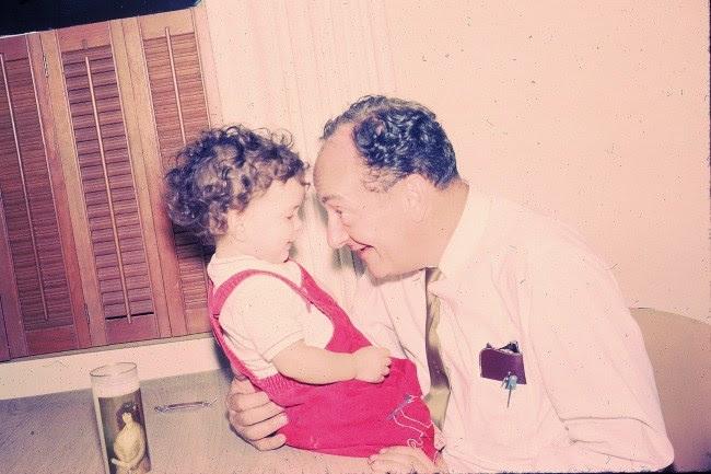Benjamin Moss plays with his granddaughter, Shelah Moss, 1966.