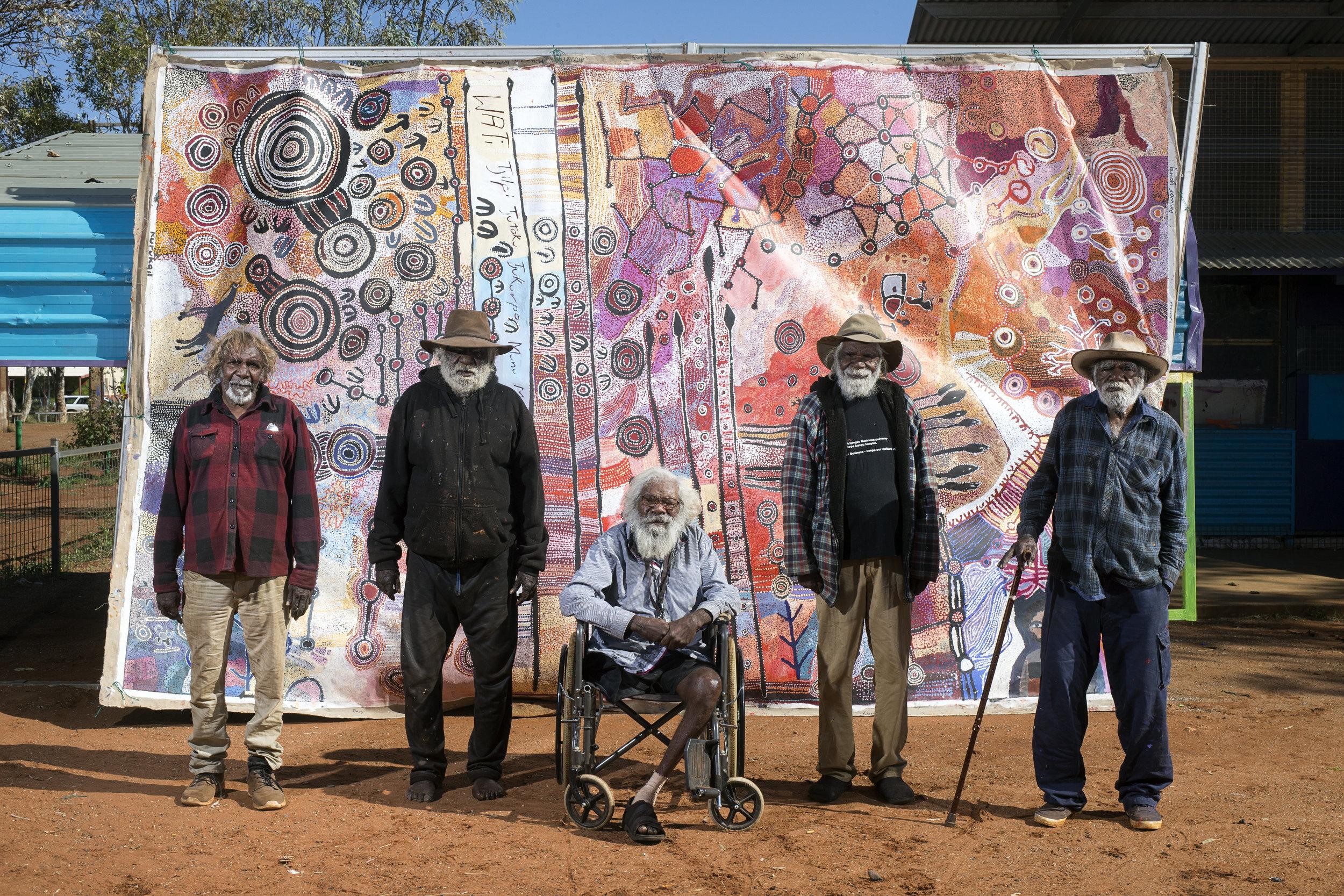 Ronnie Douglas, Brenton Ken, Willy Kaika, Mick Wikilyiri and Ray Ken. APY Men's collaborative painting 2016 Photography credit Rhett Hammerton 2016