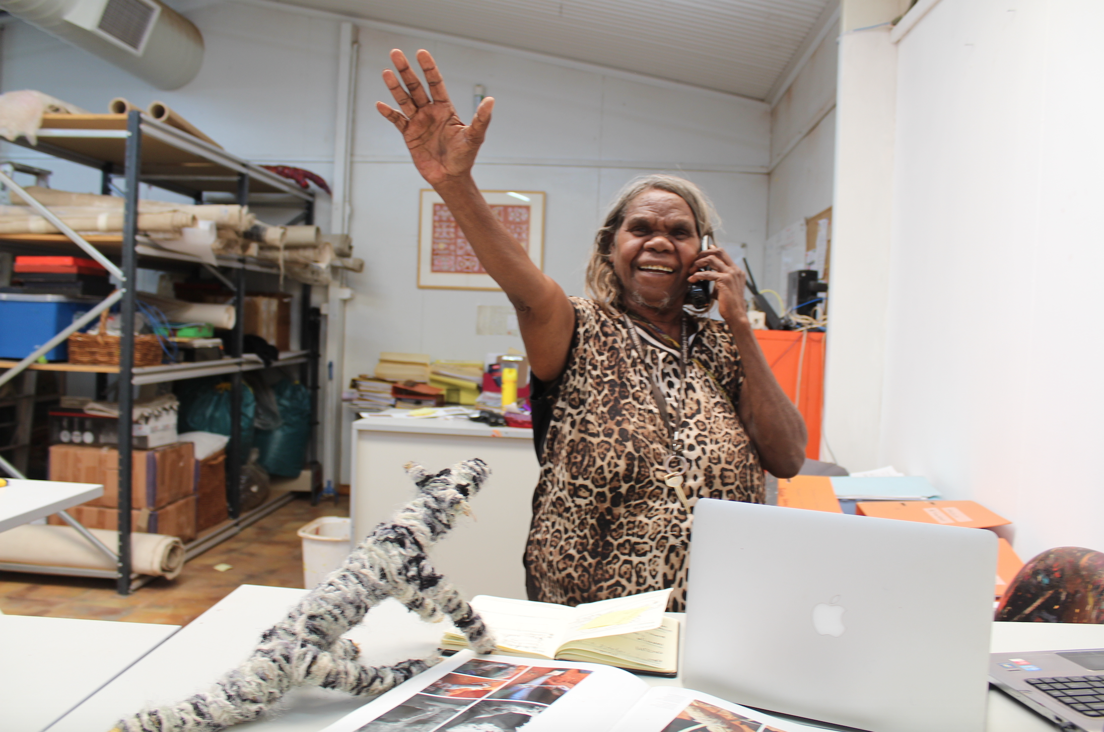 Mrs Norris takes a call at Katjiti Arts Fregon