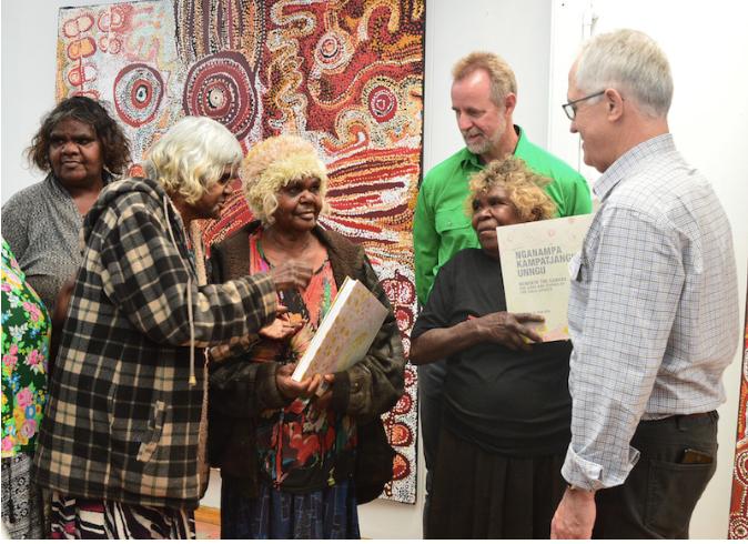 Jennifer Ingkatji, Nyurpaya Kaika, Naomi Kantjuriny and Iluwanti Ken present the Tjala Arts book to Minister Scullion and Prime Minister Malcolm Turnbull