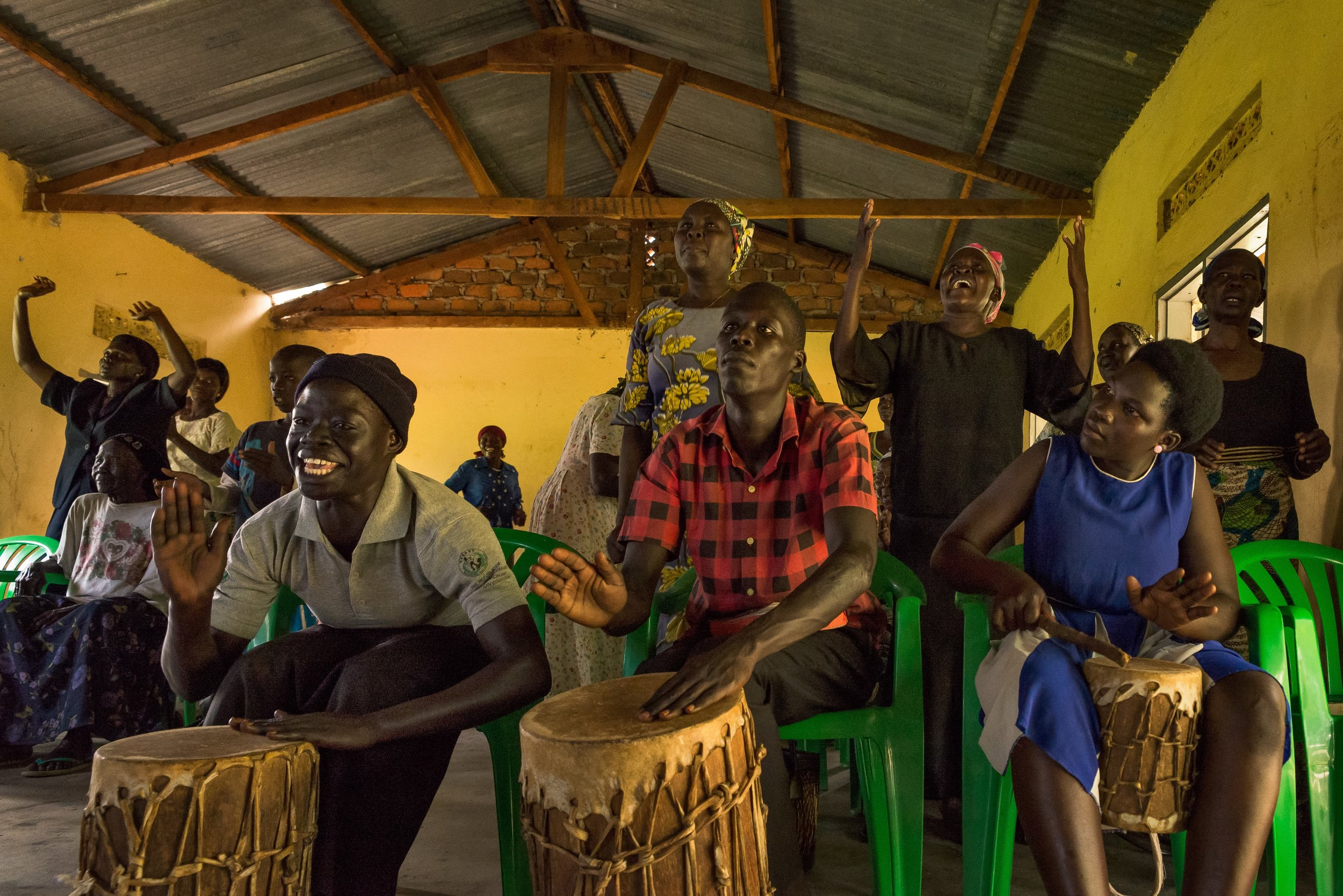 Refugees from Western Equatoria beat animal-skin drums during a P.U.S.H. service in northern Uganda.