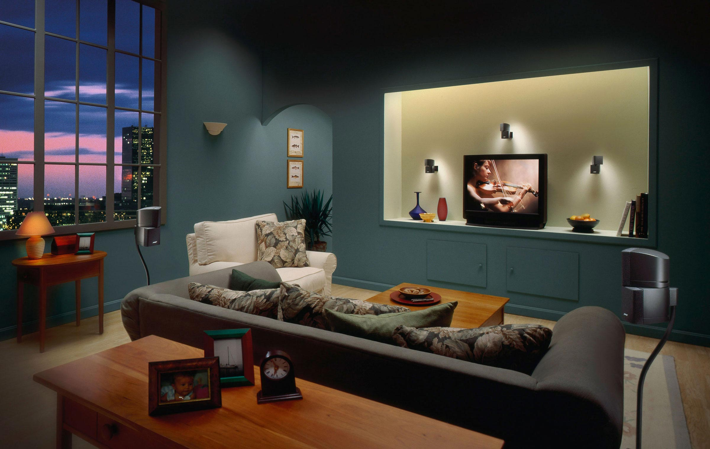 "Cityscape Home Theater   On a number of the  Bose  sets I would often use the ""hosemaster"", a fibre-optic lighting device which would allow me to dress up ninja-like and, in total darkness, move around the set and ""paint"" areas with light. The three speakers by the TV and the two on either side of the sofa are prime examples. It was pretty amazing the degree of control you could attain, after using it long enough. _________________________________________________________"