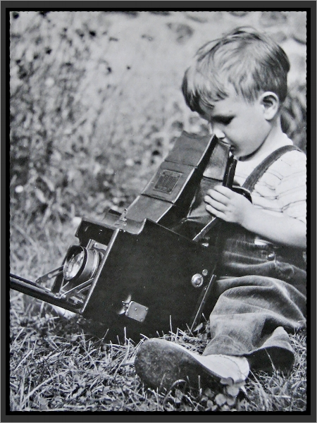 3 years old with my father's Graflex. I didn't use a camera seriously till I was 30.