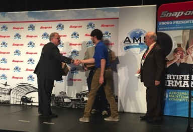 International Representative Chris Moore presents a set of Snap-on tools to the winner of the student raffle at the MRO Convention
