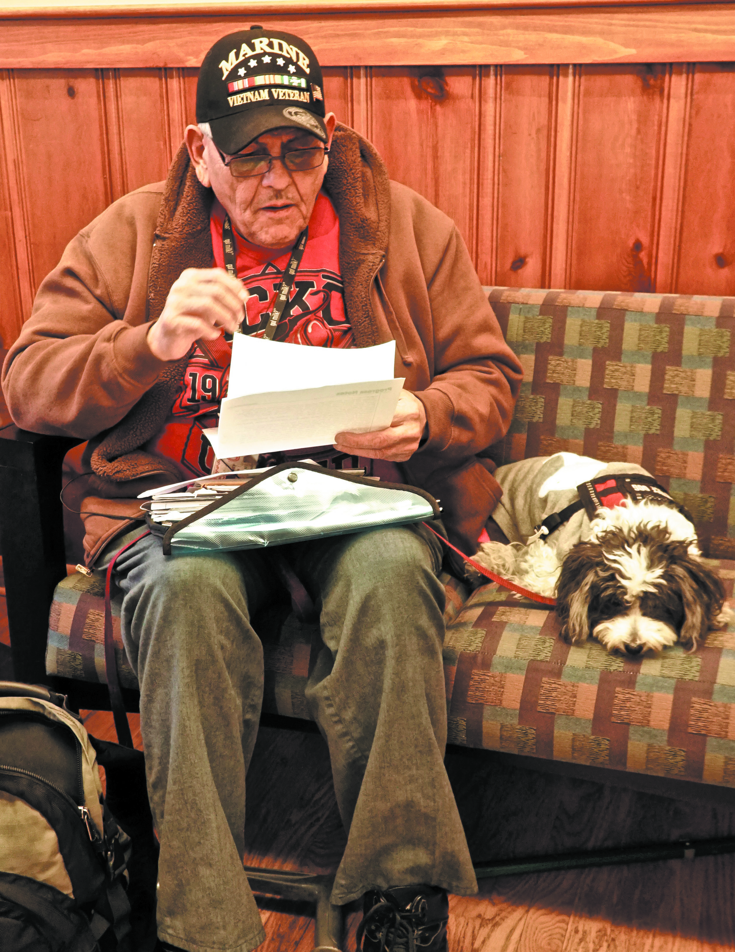 A client and his dog wait for an appointment during Peace, Love and Paws' January clinic at St. Barnabas Episcopal Church. (Credit: Barbara Millman)