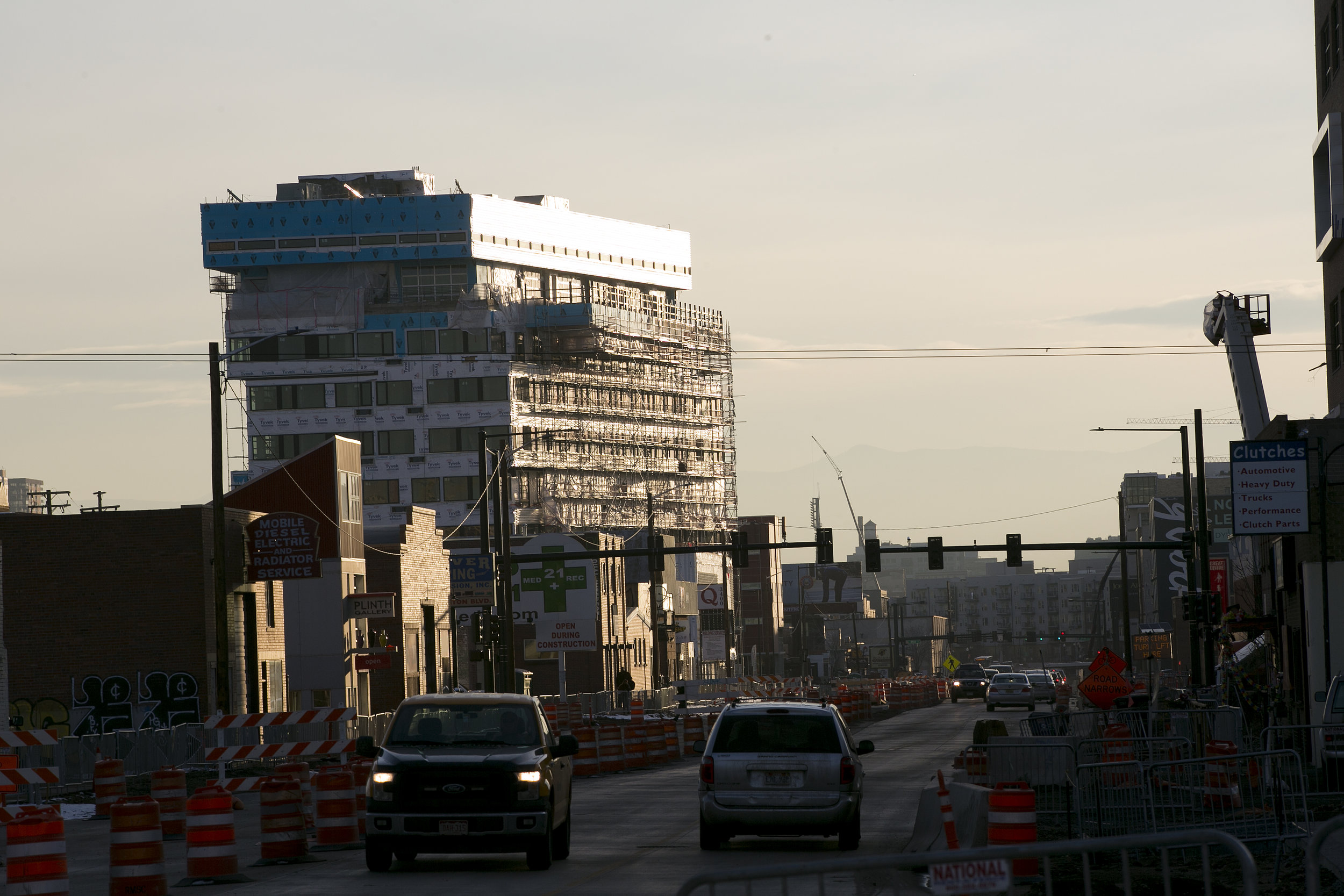 Ongoing construction on Brighton Blvd. in River North, one of the most rapidly developing neighborhoods in Denver. Jordan Artach moved out of a nearby apartment after rent rose $500 in a single month. (Credit: Giles Clasen)