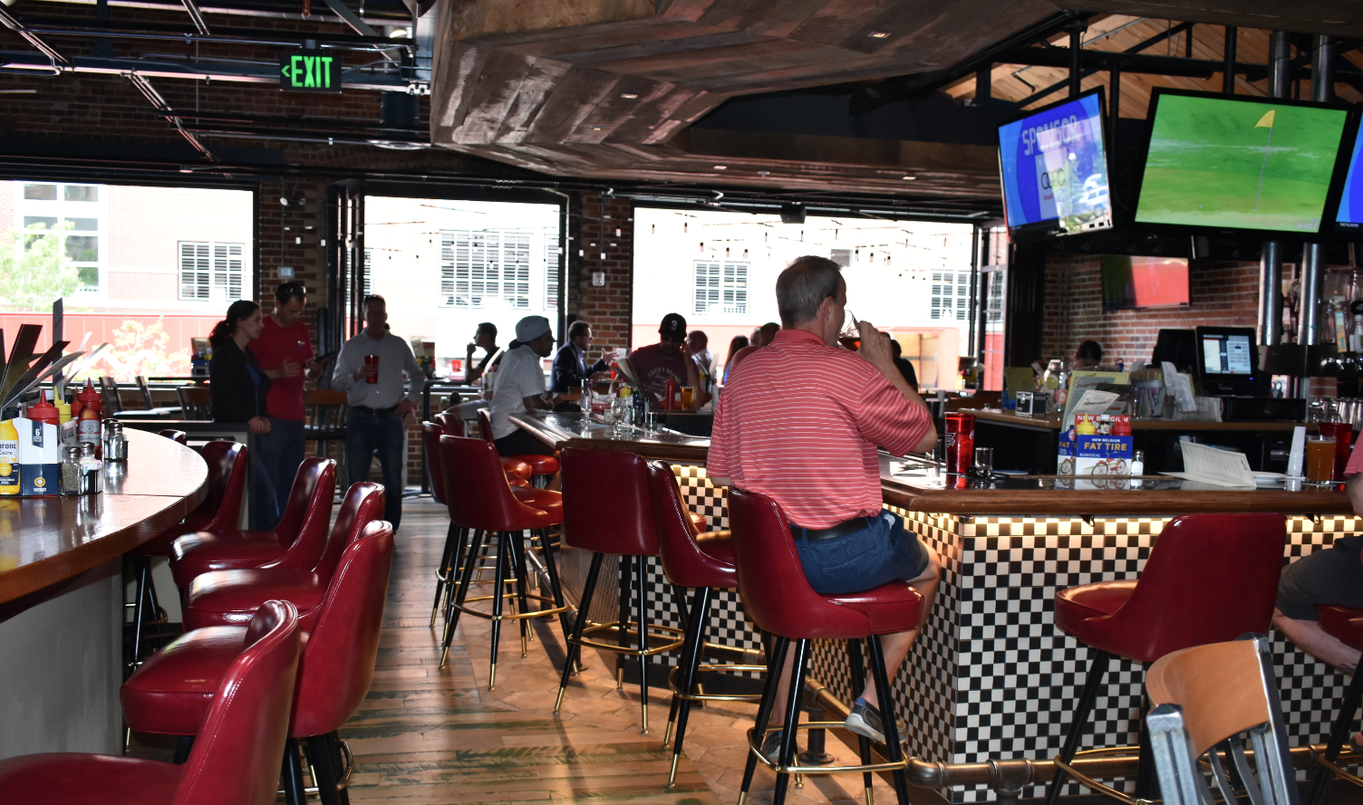 The bar area in the Cherry Cricket's recently-opened second location. The restaurant opened in the old home of Breck on Blake next to Coors Field. (Credit: Sarah Ford)