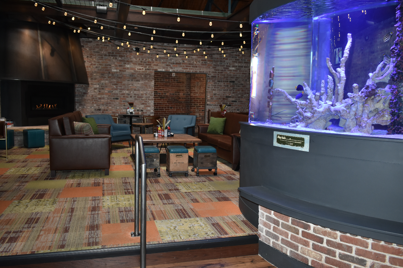 The inside of the new Cherry Cricket in the Ballpark Neighborhood. The new location includes the classic fish tank in addition to the vast seating space and bar area. (Credit: Sarah Ford)