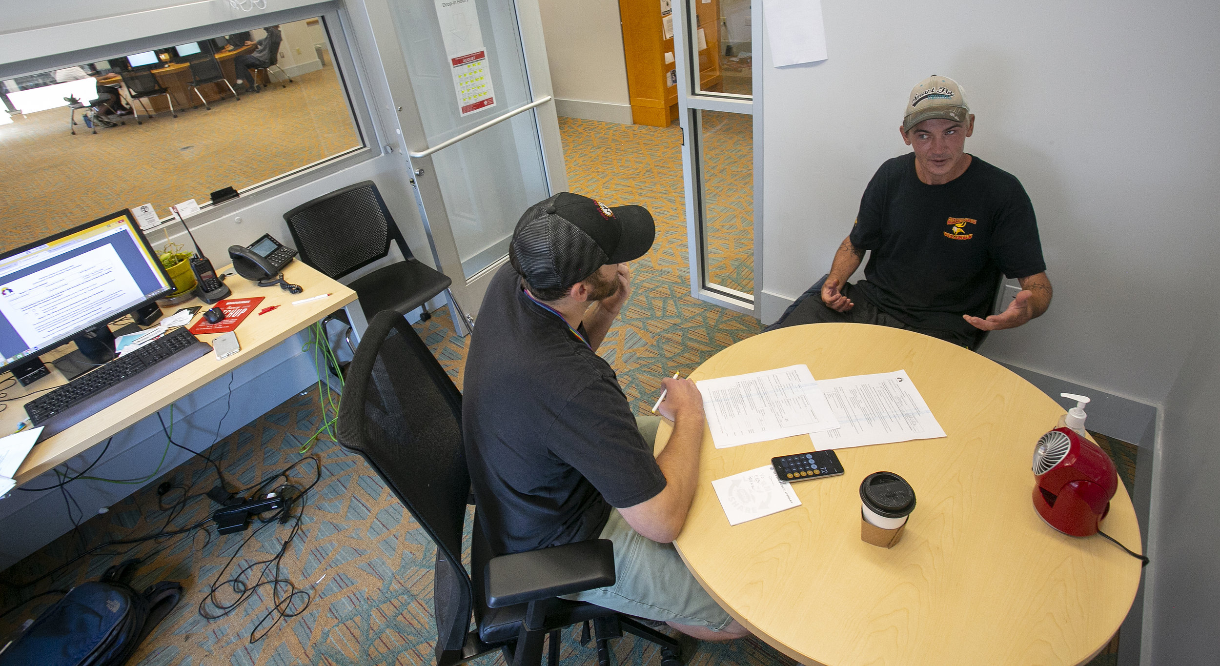 Matt Glover  administers the VI-SPDAT test to James Whitchurch. Whitchurch became homeless after being released from prison for marijuana possession in Ohio. After his release, he faced over $25,000 in back child support for the time he spent behind bars. He struggles to earn enough money to get his own apartment due to extensive garnishment of his wages. The VI-SPDAT — Vulnerability Index Service Prioritization Decision Assistance Tool — is an interagency tool used to determine risk and prioritization in helping individuals access services. By participating in the VI-SPDAT, the DPL Community Resource Team is able to help individuals enroll in the city-wide resources available to unhoused individuals.