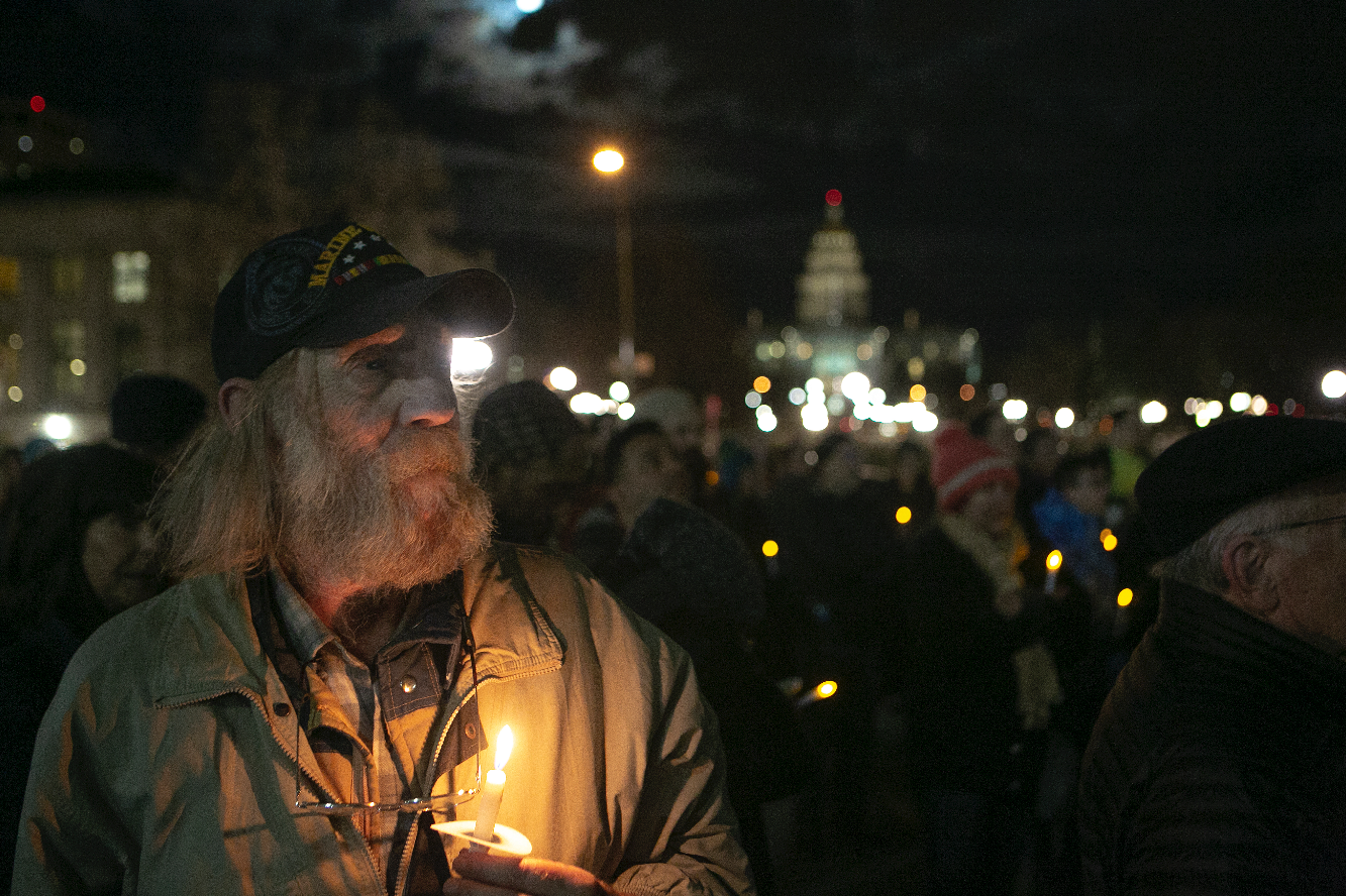 Veteran Laray Kreplin watches the 29th Homeless Person's Memorial on the steps of the City and County Building. Kreplin was homeless for several years, but says he now lives with social security in a subsidized apartment through the Colorado Coalition for the Homeless.