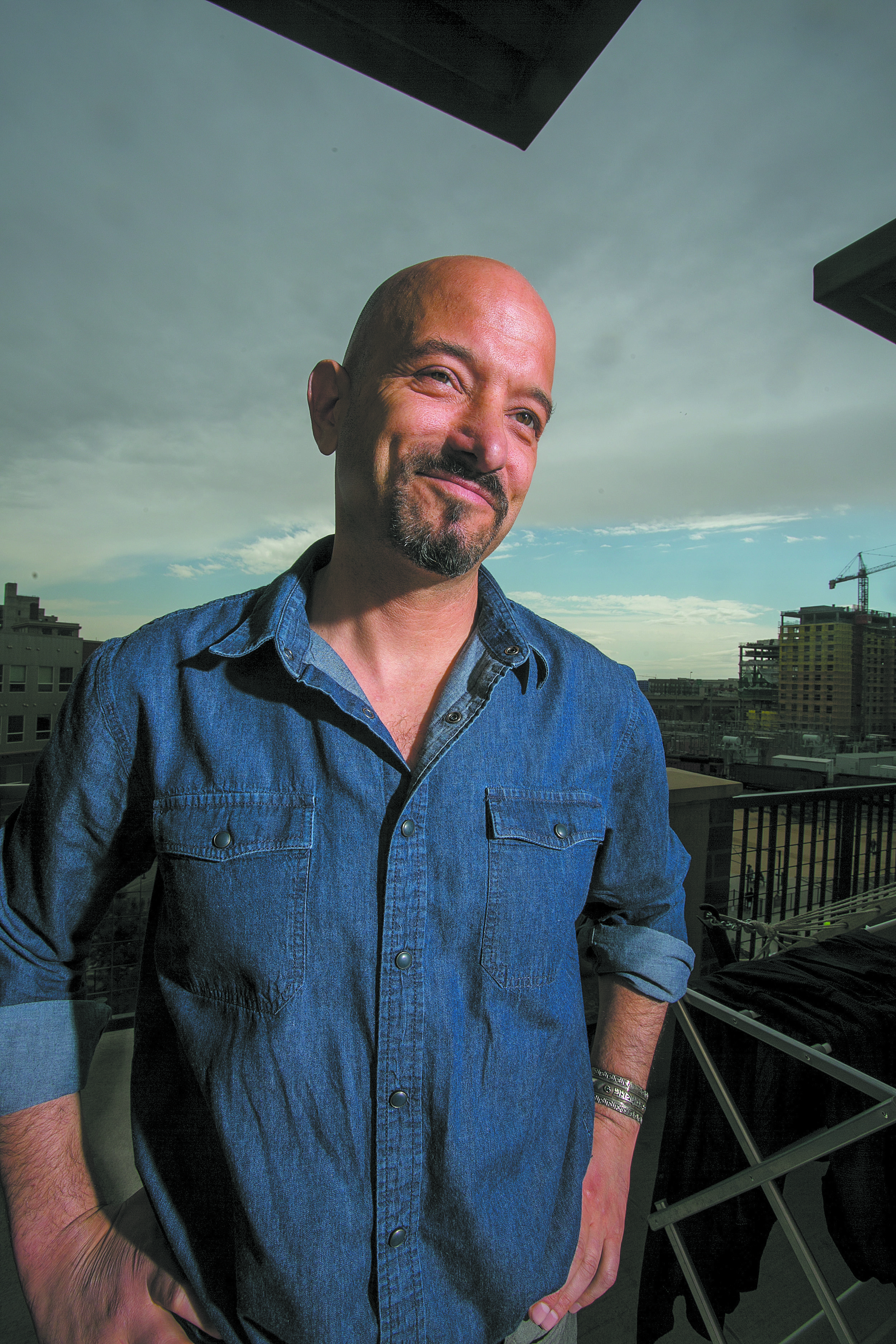 """Jason Flores-Williams, the lawyer who will represent the homeless plantiffs in the class-action lawsuit against Denver's """"homeless sweeps."""" (Credit: Giles Classen) Originally published in the May 2018 issue of  Denver VOICE."""