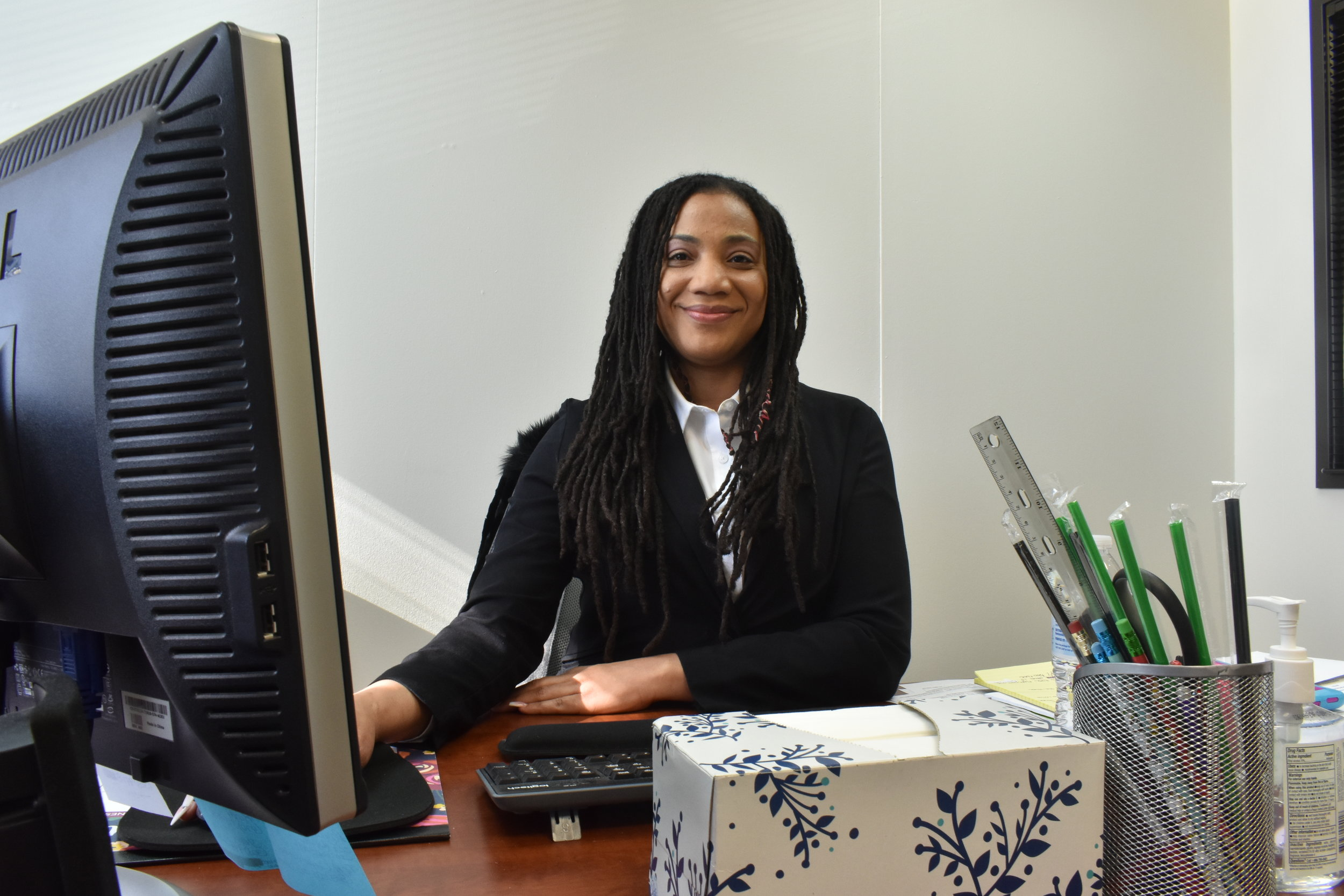 DeTonia Gooden in her office at Advanced Safety Consulting. Gooden started working with the company after graduating from the WorkNow program in July 2018. (Credit: Sarah Ford)