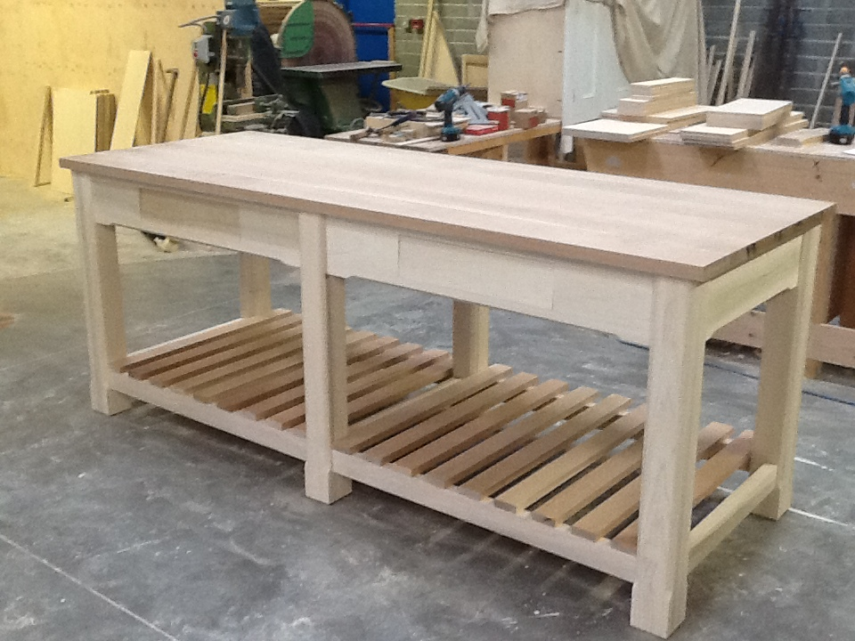 Country style island/worktable seen here before painting. Two handy cutler drawers with oak latticed shelves below. The worktop is full-stave American oak made right here in the workshop.