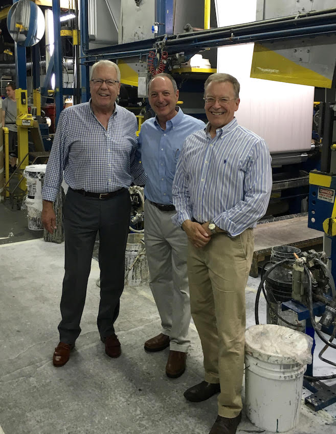 is on the floor of Len-Tex Wall-covering Manufacturing in North Walpole with Don and Charlie Lennon, owners of Len-Tex.