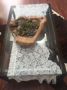 My teak wooden bowl came in handy (it's always on my coffee table). I placed succulents and rocks in it and found a lace valance and used it for a table runner.