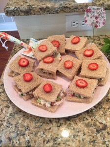Strawberry Chicken Salad Tea Sandwiches served with a floral garden shovel I purchased at Joanns.