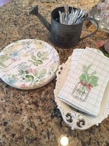 Watering can used for mini serving ware. Found these adorable hand towelettes (also have a matching dish towel) and paper plates at Joanns.