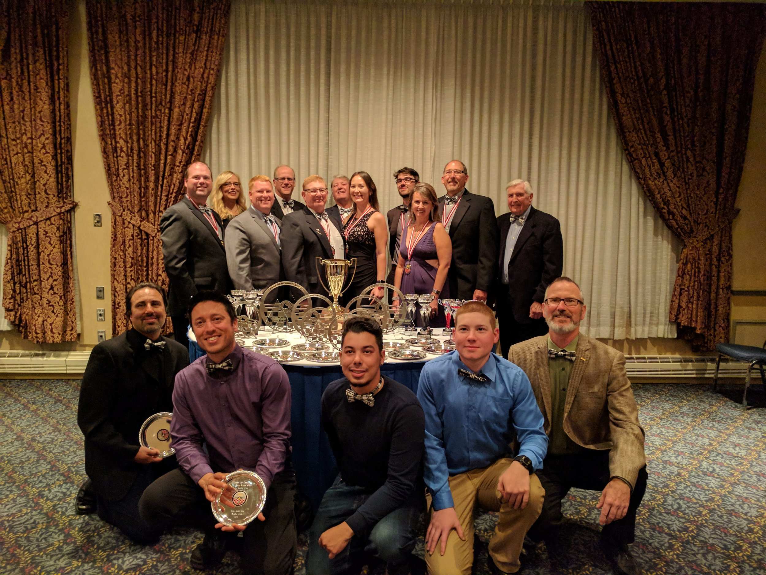 Clockwise from left: Justin Crant, Ruth Thorogood, John Hume Jr., Andrew Thorogood, John Hume Sr., Craig MacMullen, Kristina Kroner, David Jenkins, Briar DeLange, John Riddell, Ron Hume, Alan McClelland (Dean, School of Transportation at Centennial College), (Centennial Students: Matthew Yule, Jordan Rotterman and Christopher Sironi) and Garrett Nalepka (Professor, Coordinator Automotive Programs Centennial College)