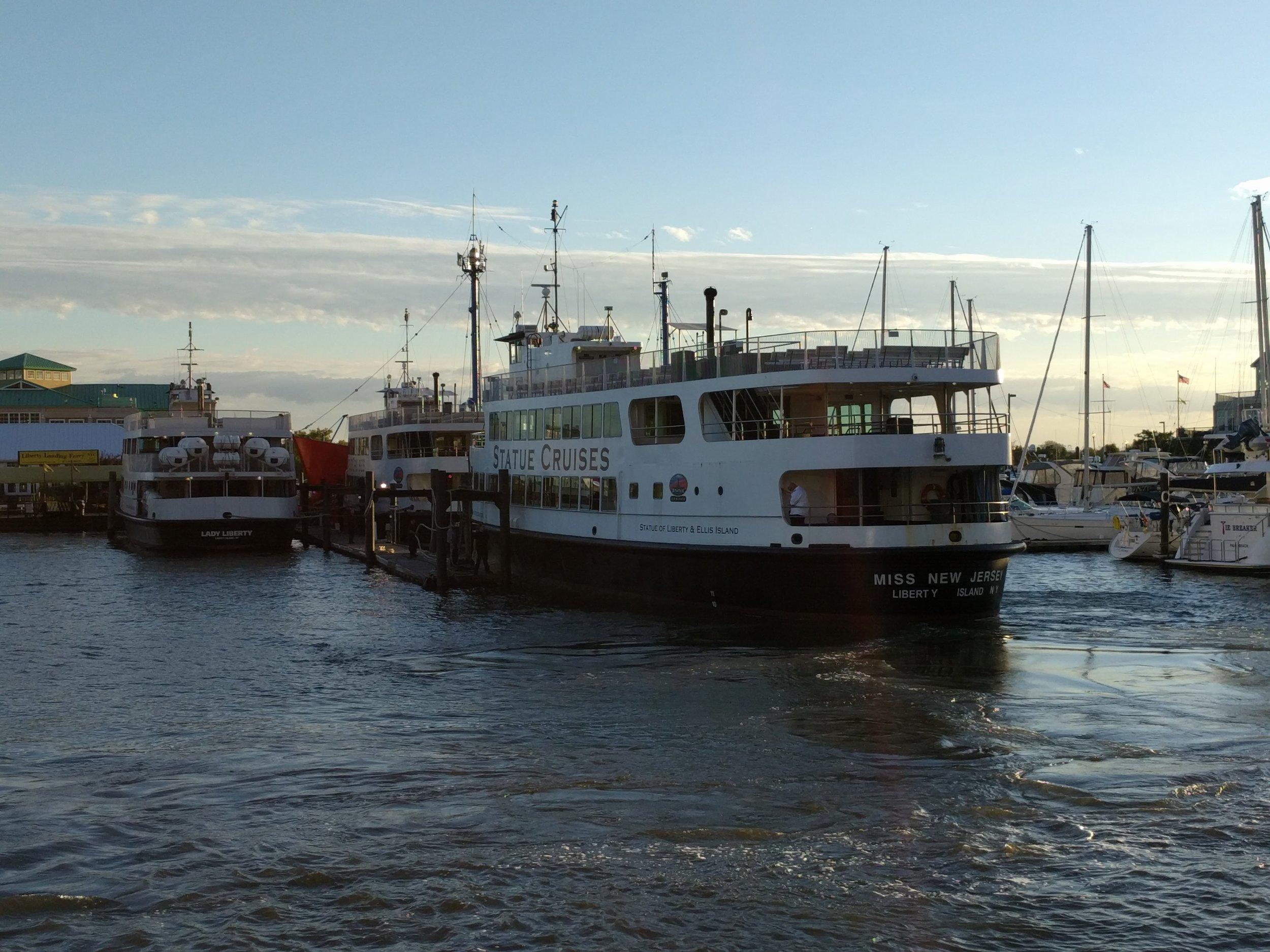 Lady Liberty tour ferries docking.
