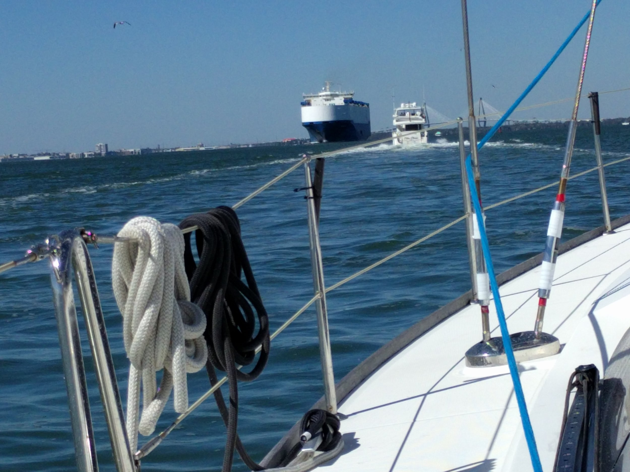 Cargo ship coming out and us heading into the Charleston's bay.