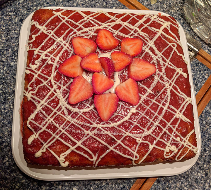 From scratch vanilla cake with strawberry coulis and white chocolate.