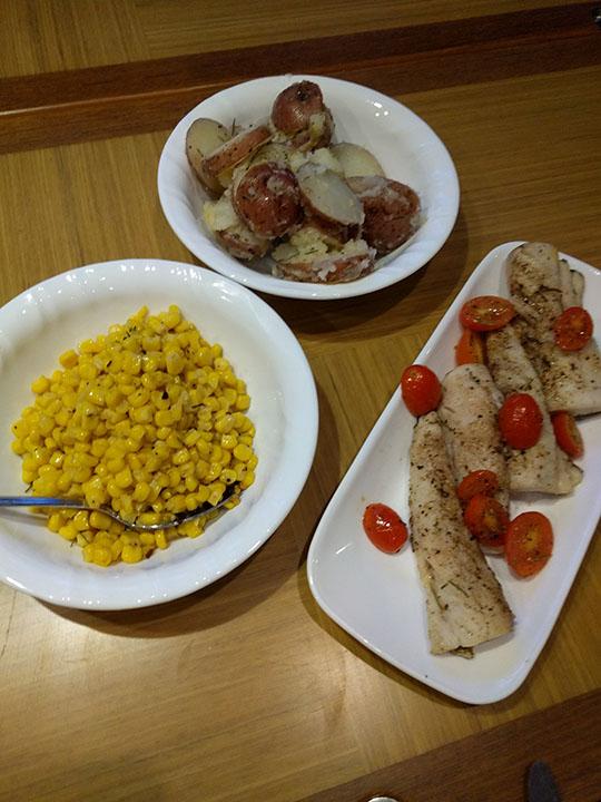 More Spanish Mackerel, seasoned corn and buttery, garlic-herb potatoes.