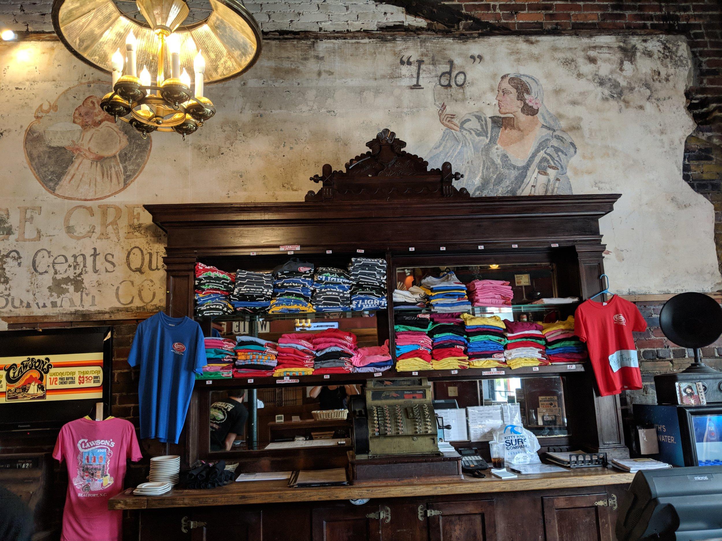 Old antique murals, cash register and display.