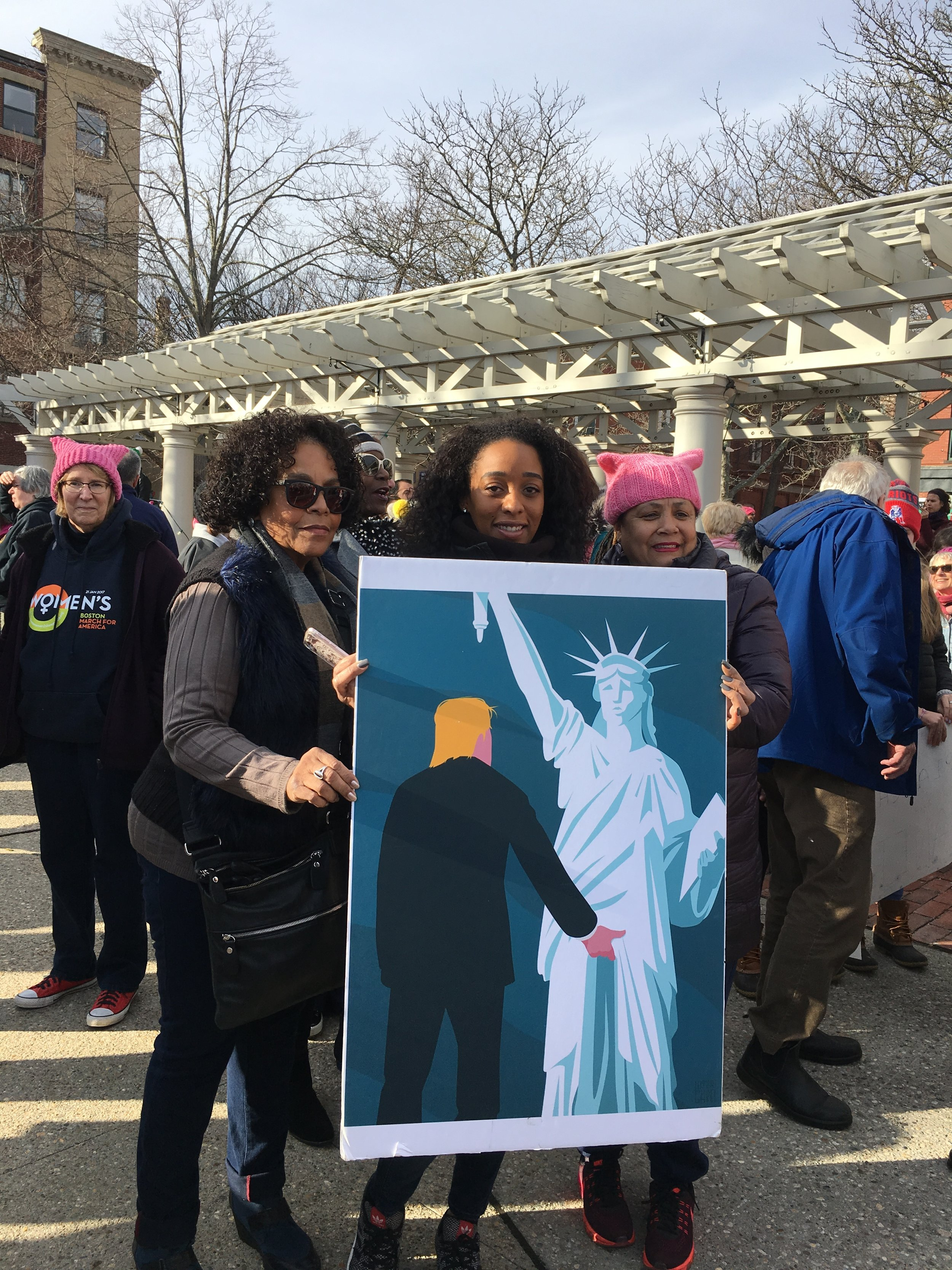Our own Carole Ferguson showed up with this poster. It was with her at the March in NYC a year ago. Seems everyone in New Bedford wanted their picture taken with it!