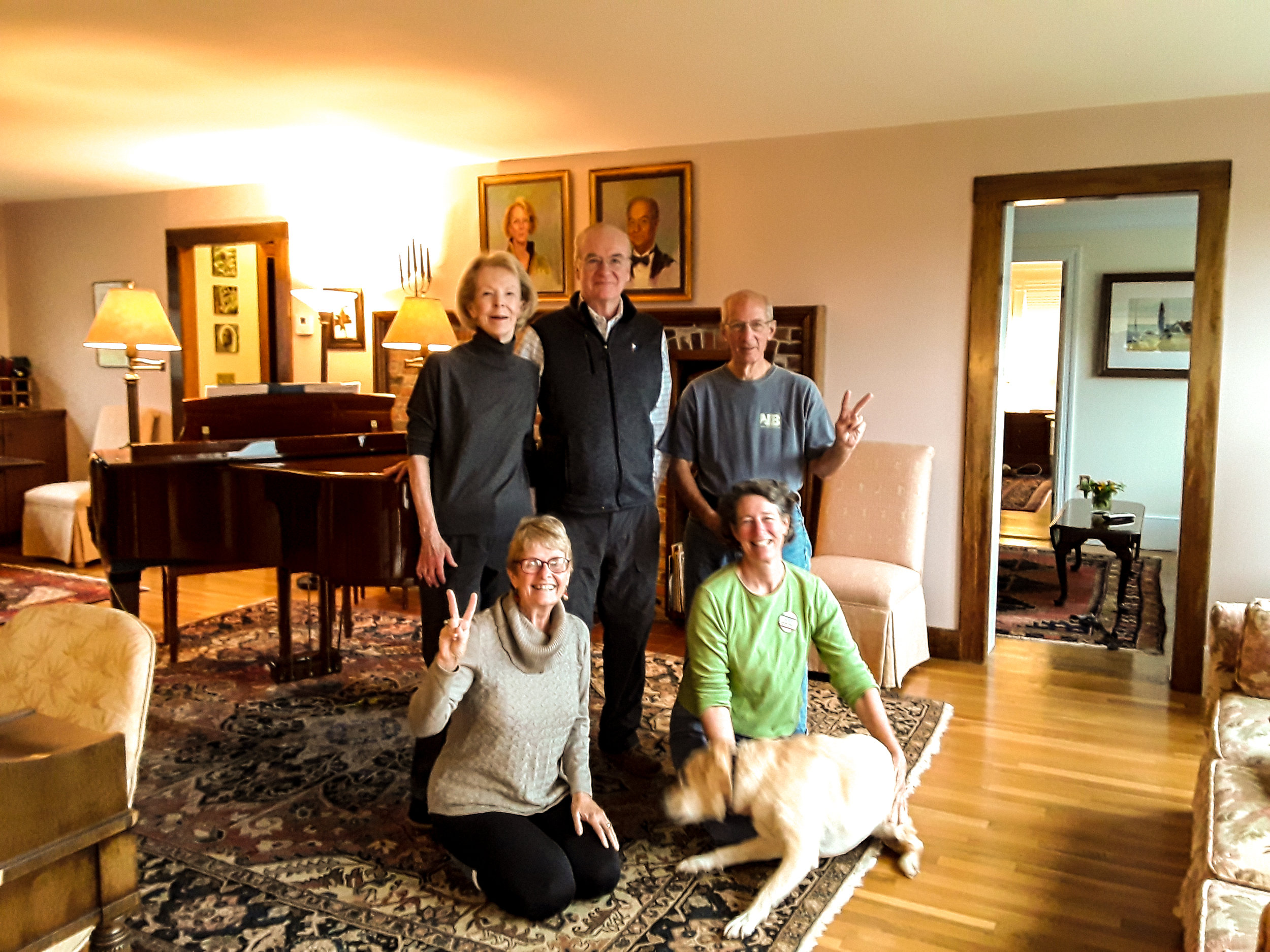 Hosts Betty LaStaiti and Edward Dufresne (back left) with Team Golden members Vic Mailey, Bettina Borders, Bess Coughlin, and unnamed emotional support dog…