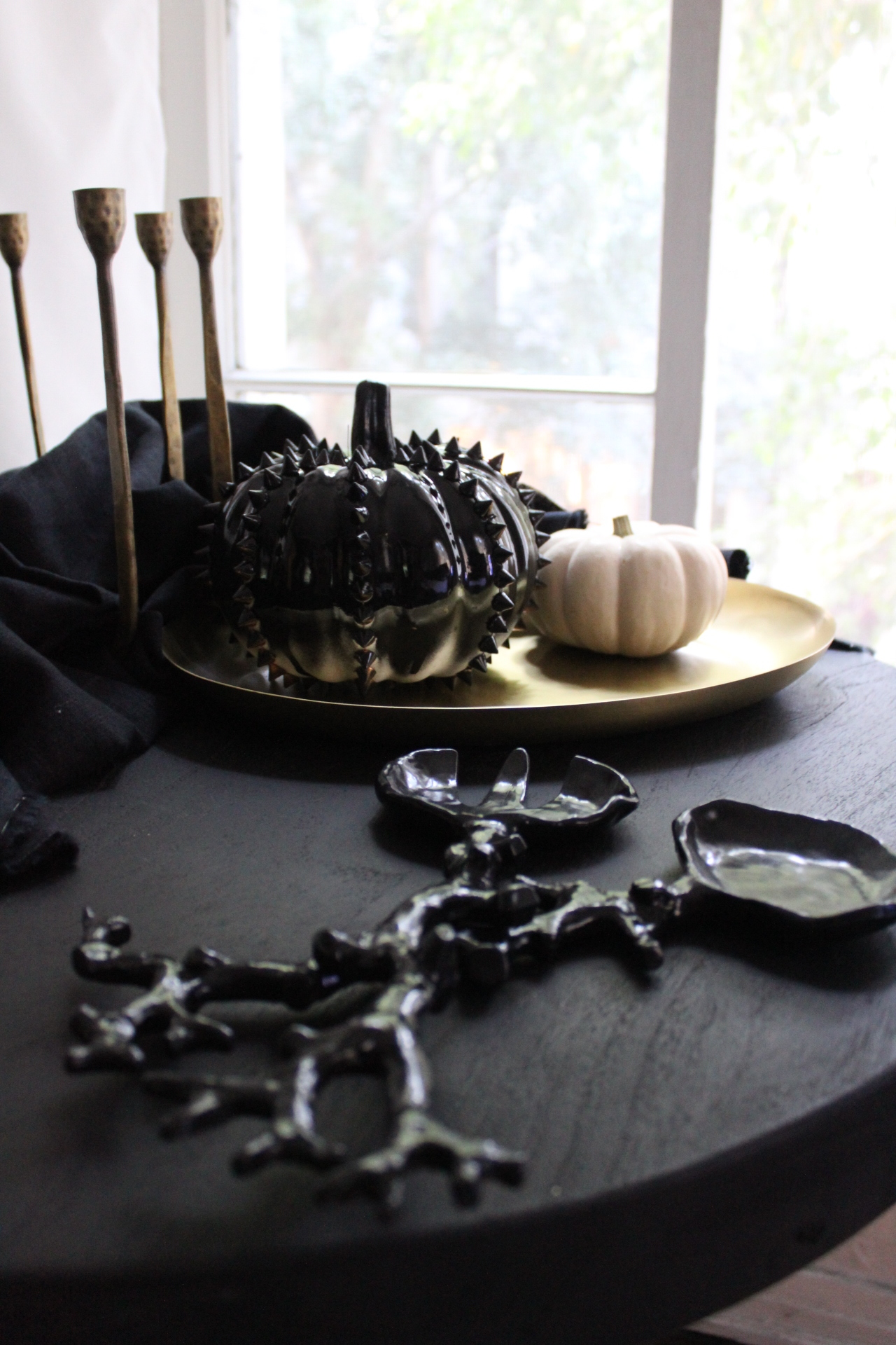 HIGH GLOSS BLACK...I love to repurpose my everyday serving and decor for holidays versus buying all new. For those of us in the city with limited storage, this can be a necessity.I was so luck to find these black coral salad servers in the Hamptons at my favorite flower and gift shop, Flowers by Rori. I used them all summer and now can turn them into creepy branch servers for Halloween! The high gloss coordinates with the spray paint pumpkins just perfectly.