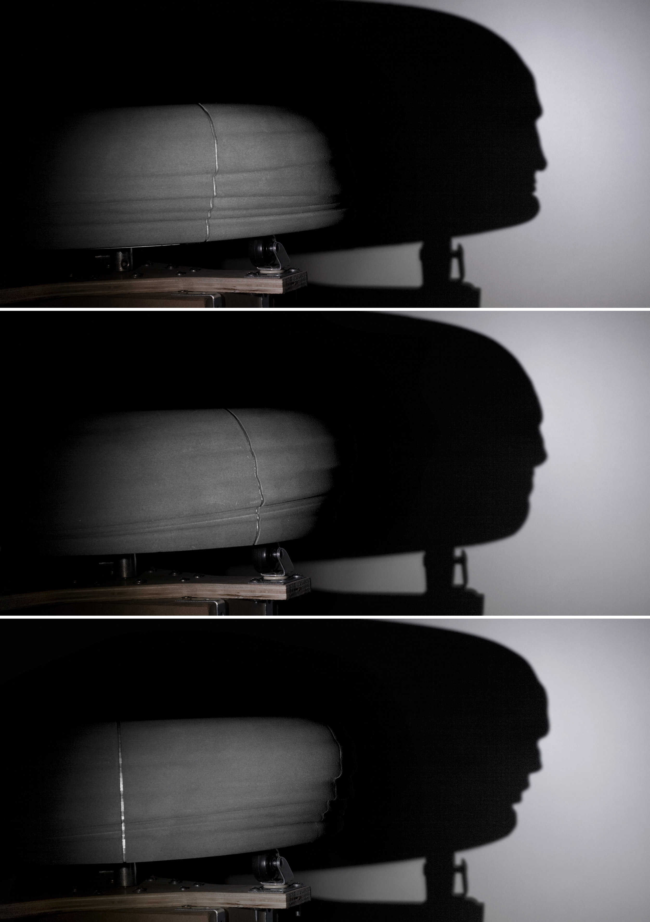 A spotlight aimed at the rotating profile edge creates a morphing face shadow