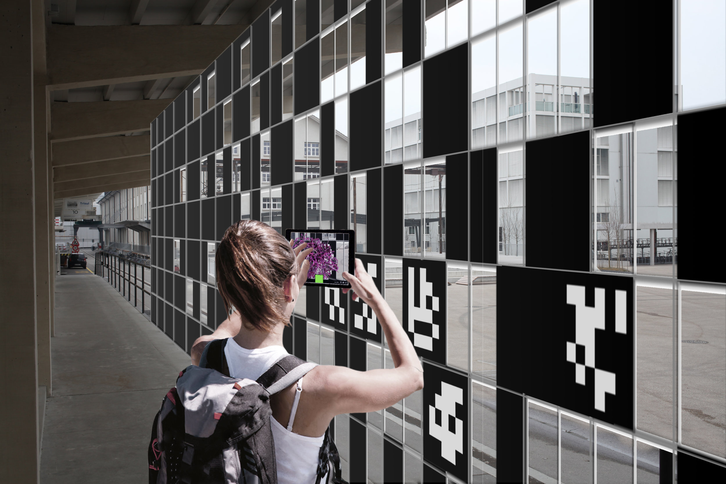 Behind the installation visitors can interact with small-scale fiducial markers to explore a gallery of AR content