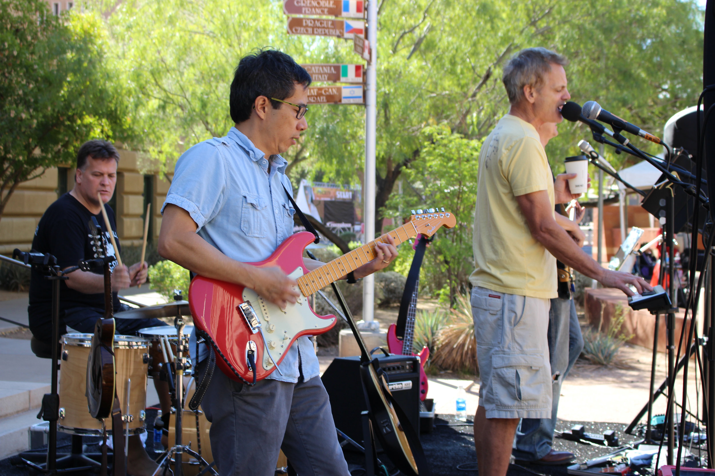Henry Wong plays guitar alongside members of local rock band The Flare at the 42nd annual TV Phoenix 10K/Half Marathon in Phoenix, Ariz. on Nov. 5, 2017.