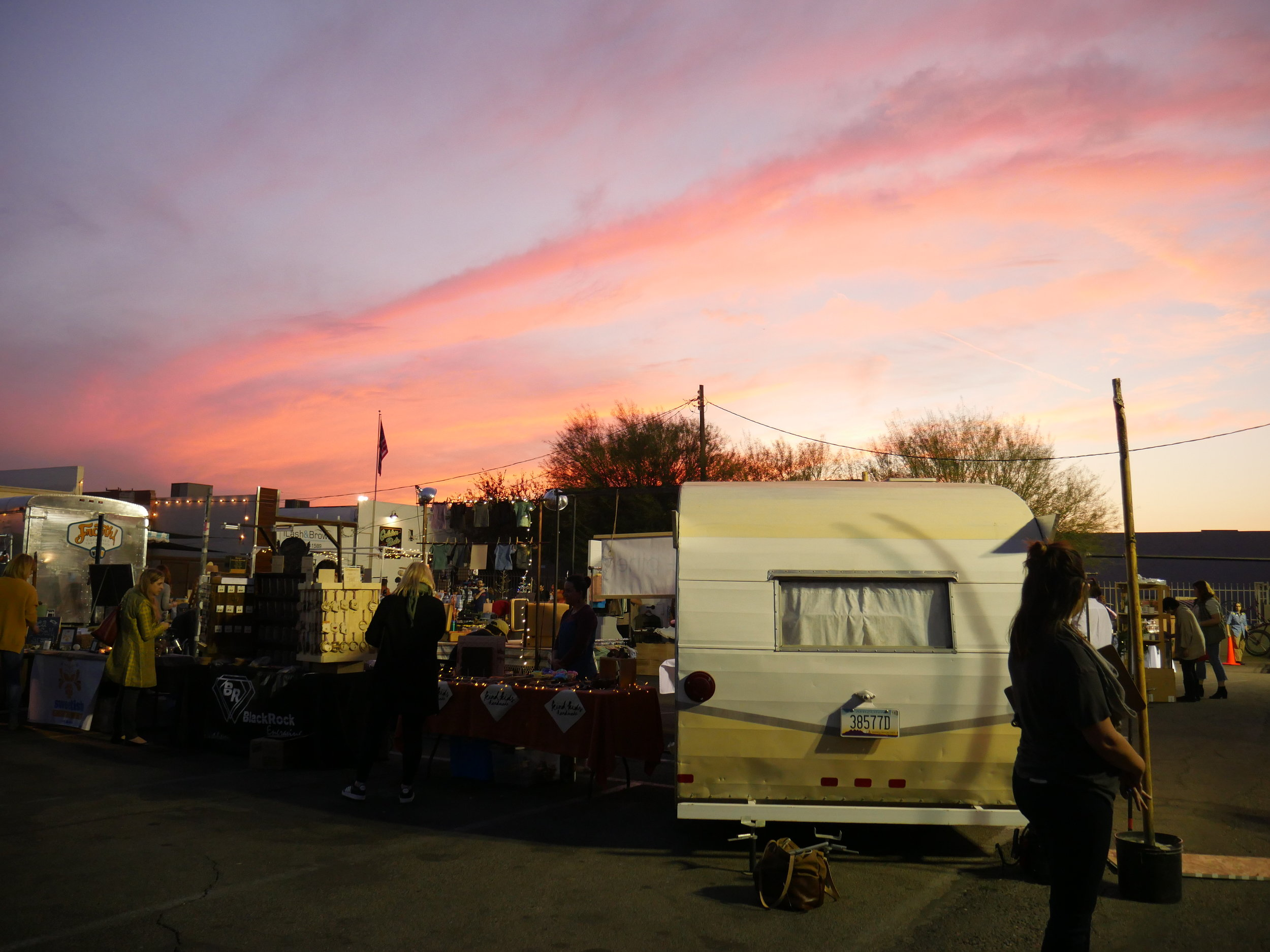 The sun sets over Crafeteria, an annual pop-up marketplace held in the parking lot behind Frances Vintage, in Phoenix, on Dec. 1, 2017.