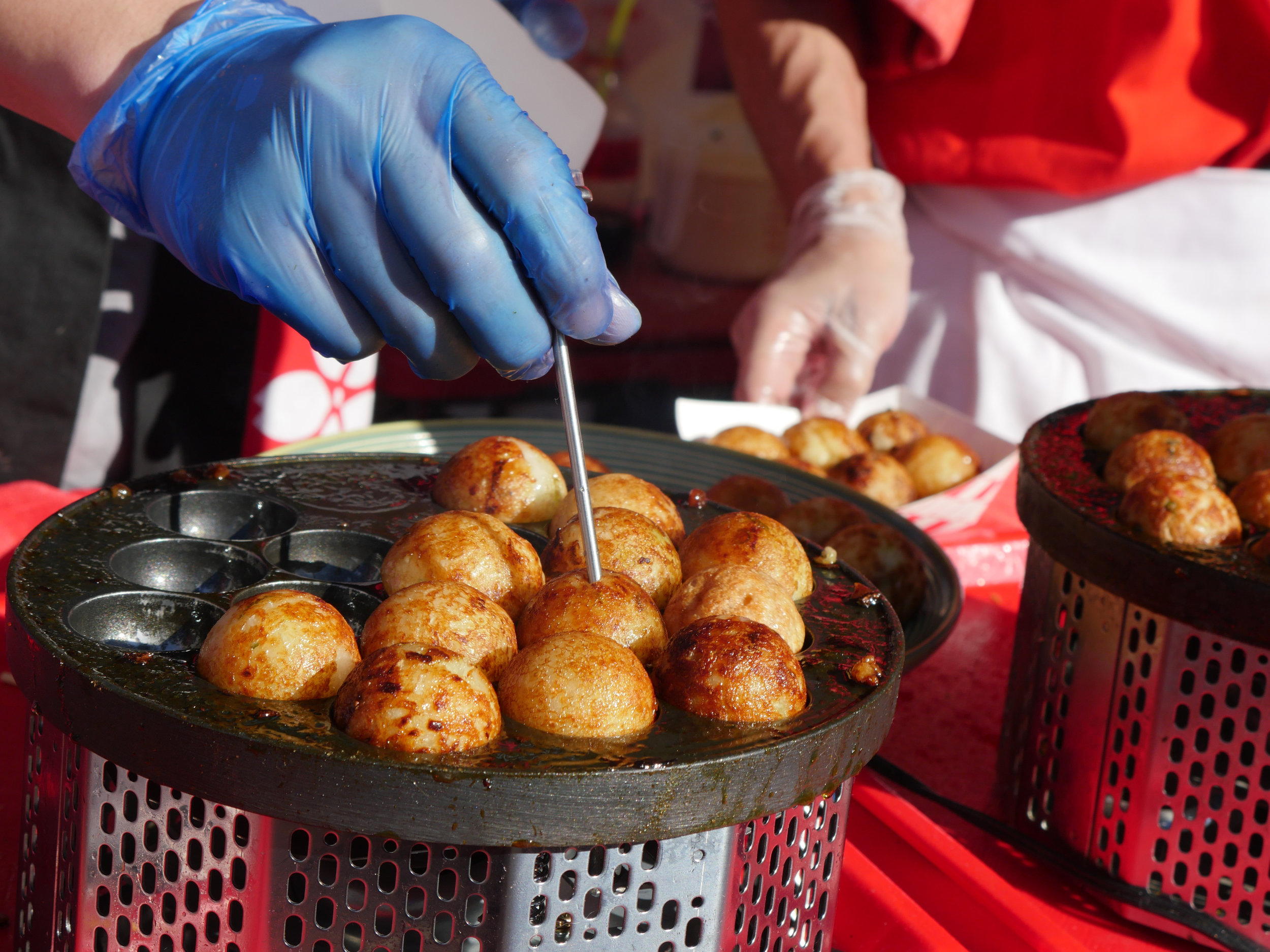 Takiyoki balls cook on a hot plate during the 34th Arizona Matsuri Festival of Japan in Phoenix, Ariz. on Feb. 24, 2018.  (Nick Serpa/azcentral)