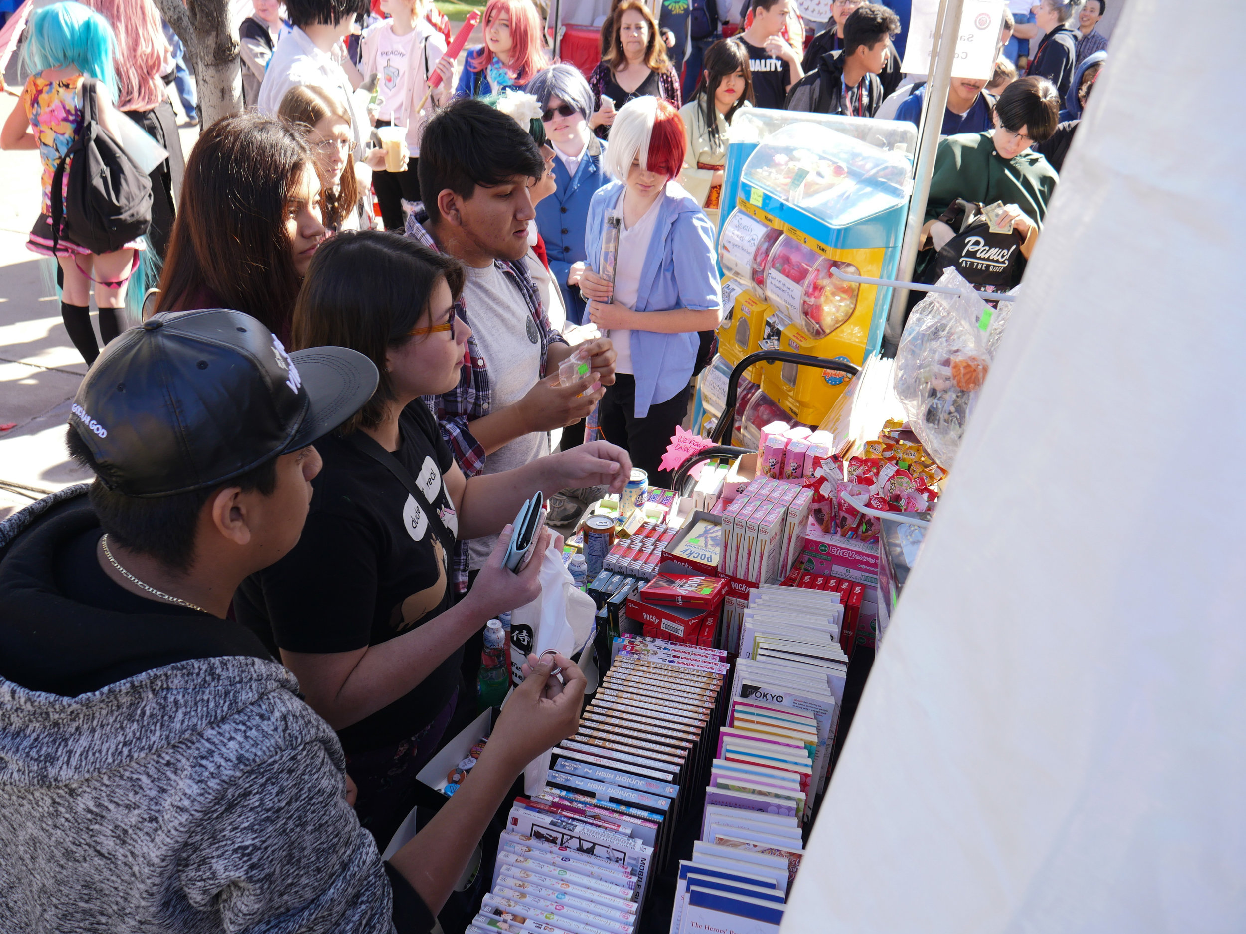 Visitors to the Arizona Matsuri Festival browse a stand full of manga, Japanese snacks and other souvenirs on Feb. 24, 2018 in Phoenix, Ariz.  (Nick Serpa/azcentral)