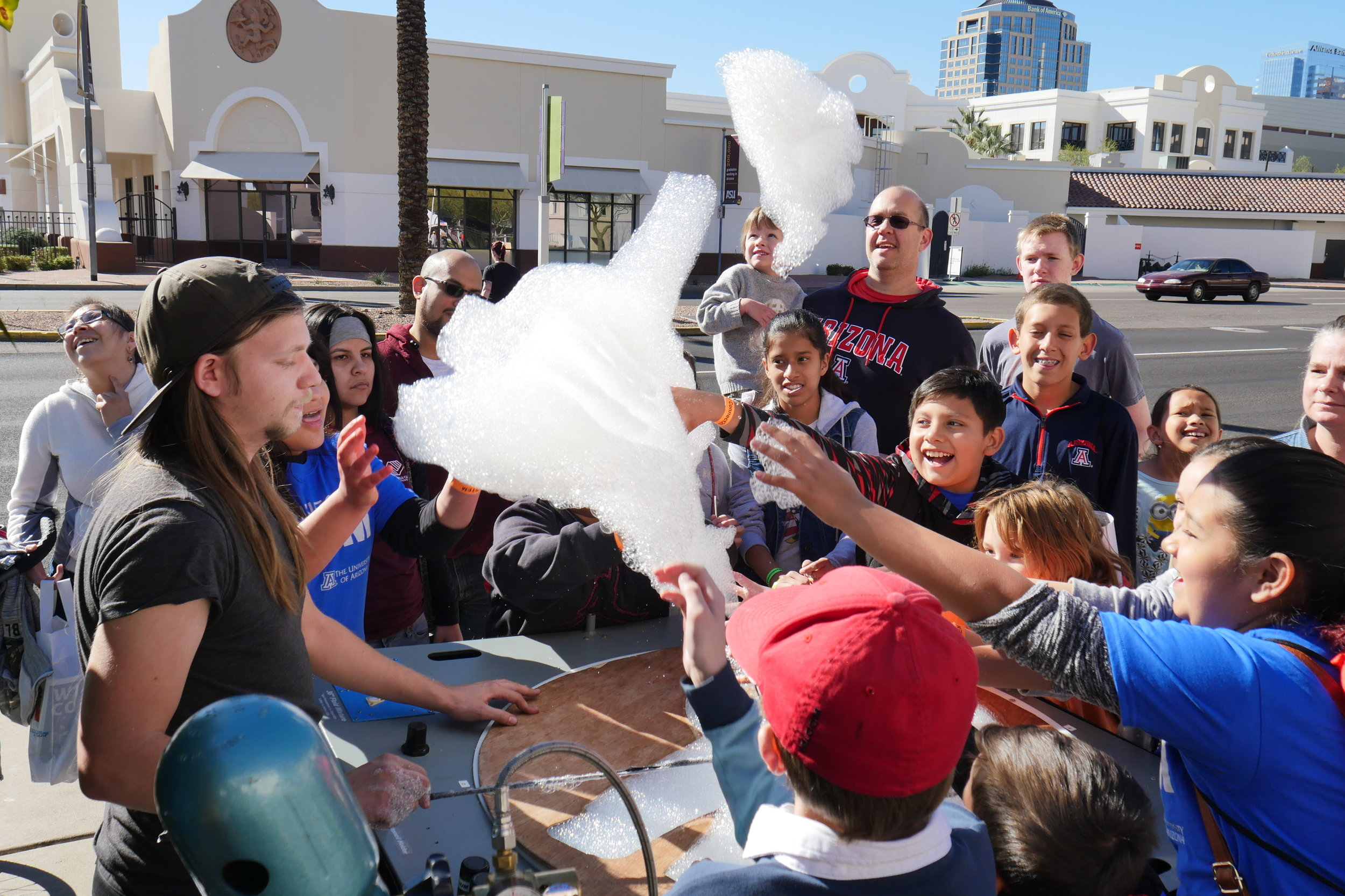 A group of students try to touch helium-filled bubbles as they float away into the sky during Connect2STEM on January 29, 2017 in Phoenix, Ariz. (Nicholas Serpa/DD).