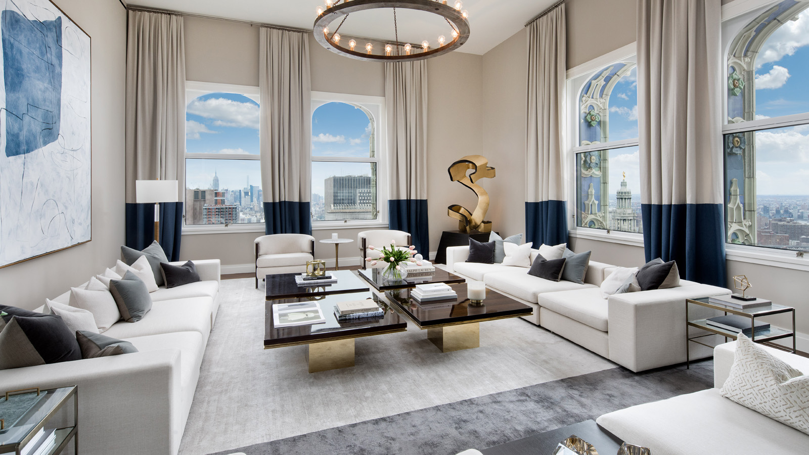 """Exhibiting a contemporary design aesthetic, the top 30 floors of the historic Woolworth building are currently offering one-to-four bedroom residences starting at $3.875MM. The building, transformed by the famed French architect, Thierry W Despont into The Woolworth Tower Residences, still remains unprecedented in size and sophistication and an elegant jewel in the skyline of downtown Manhattan.  Inside the residences, elevated ceilings, solid oak herringbone flooring, and expansive floor plans ensure a coveted, luxurious, and convenient living. The oversized windows of these residences are framed by Terra Cotta facade detailing and offer cinematic views of the surrounding cityscape and waterways.  Carefully-curated amenities for residents include a lounge, a 24-hour doorman, restored Woolworth swimming pool, gym, bike room, full-time on-site concierge and on-site parking. The residences are especially meticulously detailed to provide a cocooned lifestyle that caters to the needs and taste of any New Yorker.   CITY REALTY ARTICLE   The Woolworth Tower Residences comprise 33 condominium apartments at the top of the 60-story Woolworth Building at 233 Broadway facing City Hall Park.  The 792-foot-high building is one of the world's most famous skyscrapers and was the tallest in the world when it was built in 1912. It held that title until it was surpassed in 1930 by the Chrysler Building, which lost the title 18 months later to the Empire State Building.  Known as the """"Cathedral of Commerce,"""" it was designed by Cass Gilbert, who also designed the sumptuous United States Custom House at the foot of Broadway.  It abounds in Gothic-style tracery and Philip Johnson, the architect, told Carter B. Horsley, when he was at  The New York Times , that it was his favorite skyscraper.  The residential portion of the building has a 2 Park Place address.   CONTACT US FOR MORE INFORMATION ABOUT THIS AND OTHER NEW DEVELOPMENTS IN NYC, BROOKLYN & QUEENS     The building was designated """