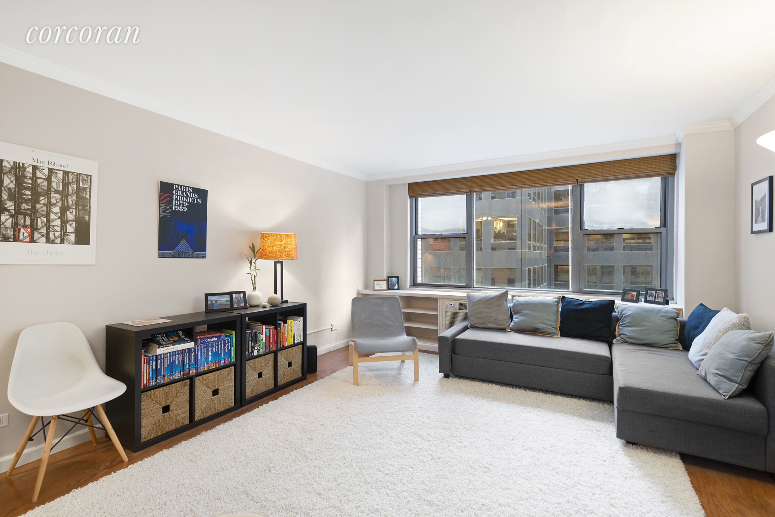 Available July 1st! Move right into this spacious one-bedroom at  The Sterling , a full service building in Midtown East. The owner recently renovated the bathroom with a Toto toilet & spa-like shower. The kitchen is also renovated with stainless steel appliances and is open to the living area. The living area has room for a large dining table, full size couch and faces south onto 56th street. There are custom window treatments in both the living room and the bedroom. The bedroom easily fits a king-sized bed and desk and there are two large closets in the bedroom, and two large closets including a linen closet in the entry & hallway. Easy board application. No Pets.  The East 50's allow access to the 4, 5, 6, E, M, N, R, Q, & F trains as well as many attractions such as Rockefeller Center, Central Park, & MoMA; shopping including Bloomingdale's, Home Depot, & Bed Bath and Beyond; and dining options from Smith & Wollensky, Le Cirque, to Whole Foods. The Sterling is pet-friendly & features a 24 hour doorman, 2 elevators, live-in super, laundry room, and roof deck.