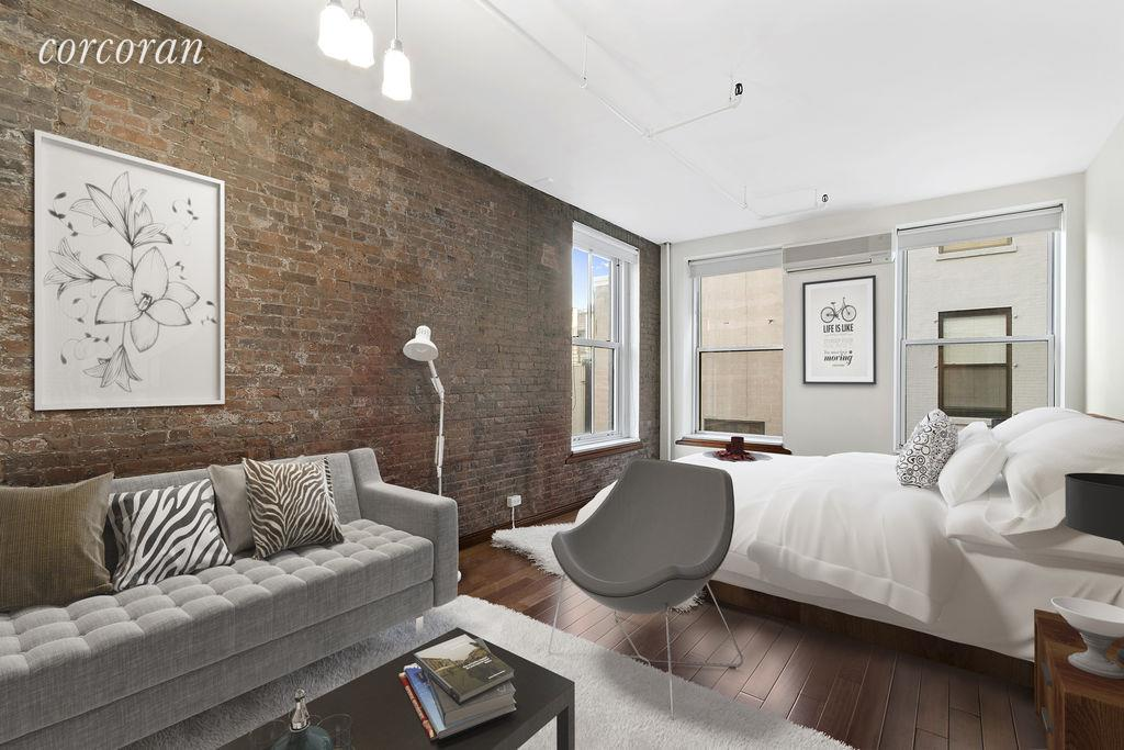 Located in the most prime section of Soho,  426 West Broadway #4C  is a large 550 square foot lofted studio with exposed brick throughout. The unit was recently renovated with cherry floors and chefs kitchen with stainless steel appliances and plenty of cabinet storage and counter space. The 11 foot ceilings were perfect to create a built-in loft that can accommodate a queen sized bed with bookshelves and two large closets in the unit. The apartment has west and south exposures that is nice and quiet in the back of the building and receives light throughout the day. The Broadway House Condominium is an elevator building with a Part-Time doorman right in the heart of Soho with free laundry on each floor. Pets will be considered by owner on a case-by-case basis. Located nearby are the C,E, N, R, B, D, F, M and 1 trains, dry cleaner around the corner and Gourmet Garage down the street.