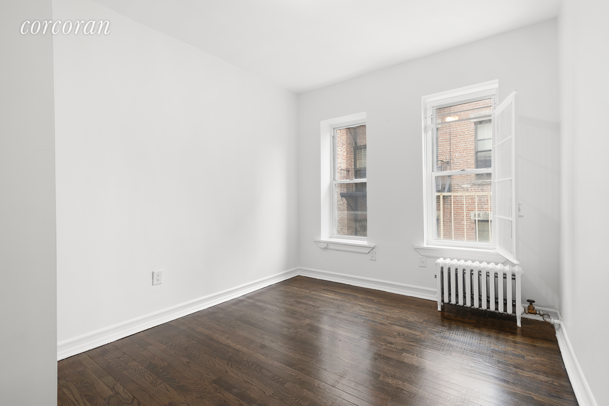 This is the best priced two bedroom rental in the East Village! Up two short flights into  317 East 3rd #16  where there are five windows in the apartment providing lots of natural light throughout the day (& multiple exposures for air flow). The living area can accommodate a couch, dining table and tv stand. The windowed kitchen has plenty of counter and cabinet space for cooking. The building is in excellent condition with video intercom system and provides free Verizon Fios internet to all occupants.
