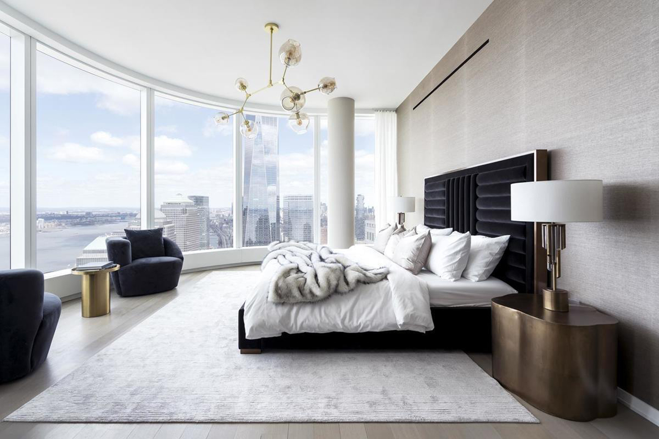 50 West on 50 West Street is a skyscraper, with architecture by Helmut Jalan, now also renting unsold residences. This residential building offers the best a home could offer, with its idyllic exterior and contemporary, meticulously-detailed interiors imagined by Thomas Juul-Hansen.  All homes feature oversized windows framing unparalleled views of the city and of the Manhattan skyline, expansive and generous floor plans and open kitchens. The floor-to-ceiling curved glass windows allow the homes to be airy and lit with natural light. A wide and carefully-curated amenities package is to be enjoyed by the residents of this landscaped plaza.  Amenities include a pet-friendly environment, a fully-equipped fitness center, a Water Club, doorman and concierge services, a bike room, a media doom, a swimming pool, and a children's playroom along with a package room. Alongside this, the tower enjoys a lively neighborhood, within the radius of subways and Financial District.   CITY REALTY ARTICLE   The shimmering sentinel at 50 West Street is a major addition to Lower Manhattan's celebrated and changing skyline. The 778-foot-high tower has a roof slanted upwards toward the pinnacle of One World Trade Center, a few blocks to the north. The Financial District building has 191 condominium apartments and was developed by  Time Equities . The 64-story structure, with floor-to-ceiling windows, was designed by  Helmut Jahn .  Four floors of the tower are devoted to amenities that include a fitness center and a 64th floor outdoor entertaining space with far-reaching views of New York and beyond. The location is one block from the 1, R/W and 4/5 subway lines and is in close proximity to attractions such as Battery Park and the  Hudson River Promenade .   CONTACT US FOR MORE INFORMATION ABOUT THIS AND OTHER NEW DEVELOPMENTS IN NYC, BROOKLYN & QUEENS!
