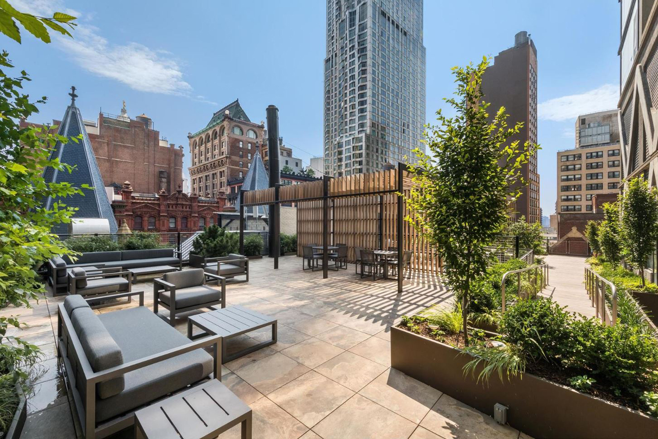 """This new construction stands adjacent to The Beekman, a newly renovated historic hotel with commendable service. The tower enjoys arched arcades, ornate railings, and a very large, sky lit atrium. This red terra-cotta building was imagined by Gerner, Kronick and Valcarel and frames exquisite 360 degree views of the Manhattan skyline on its modern canvases.  Inside the residences, the vision of Thomas Juul-Hansen exhibits generous and expansive floor plans, huge windows and soaring ceiling heights. The interior features rooms and spaces that promise a luxurious, contemporary and convenient living to its residences.  A carefully -curated amenity package has been prepared for the residents, offering a private dining room, doorman and concierge services, a media room, expansive rooftop terrace, elevator excess and a state-of-the-art fitness center. Amongst all these benefits, the residents can also enjoy priority reservations for the hotels Temple Court and Keith Mc Nally's Augustine.   CITY REALTY ARTICLE   The Beekman Residences are 68 condominiums in a 51-story tower at 115 Nassau Street adjacent to Temple Court, the 10-story, former 1883 office building at 5 Beekman Street with tall pyramid corners just a few feet east of Park Row at City Hall Park.  The red terra-cotta building on Beekman Street is being converted to a 287-room hotel with a very large, skylit atrium with very decorative and ornate railings and arched arcades that is very reminiscent of one of the major scenes in """"Bladerunner,"""" the famous movie that was partially shot in the famous Bradley Building in downtown Los Angeles.  The new, adjacent tower is """"a dynamic reinterpretation of the cast-iron elevation of The Beekman Atrium; exposed and engraved concrete columns create a muscular elevation that celebrates the structure of the tower,"""" according to Randy Gerner of Gerner, Kronick + Valcarcel the architect for the project. """"Above all,"""" he continued on the project's website, """"the tower's dual crowns a"""