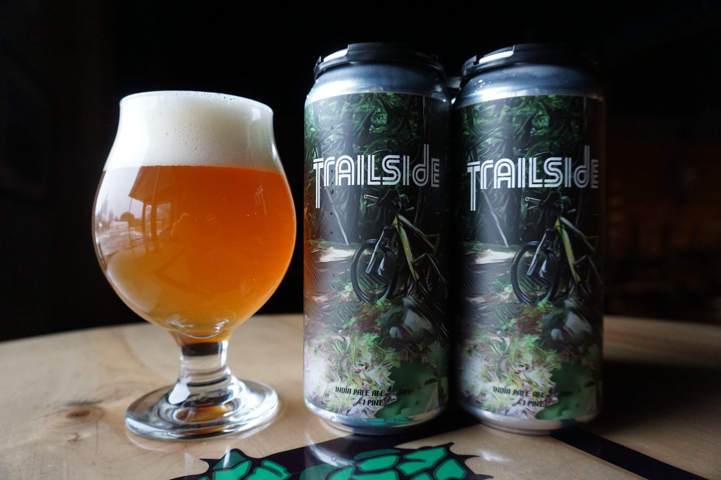 Trailside IPA, 7% ABV - A throwback recipe from the days of home-brewing. TRAILSIDE is a golden IPA hopped with simcoe, cascade and centennial with a big citra dry hop. Notes of citrus and pine with a refreshing dry finish