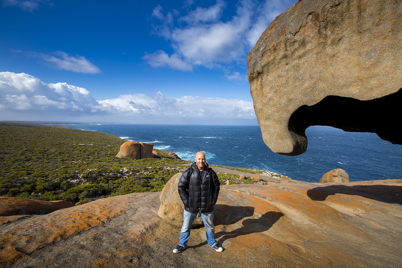 Earth Trotter Photos' Chris Taylor stands atop Remarkable Rocks on Kangaroo Island near Adelaide, Australia.
