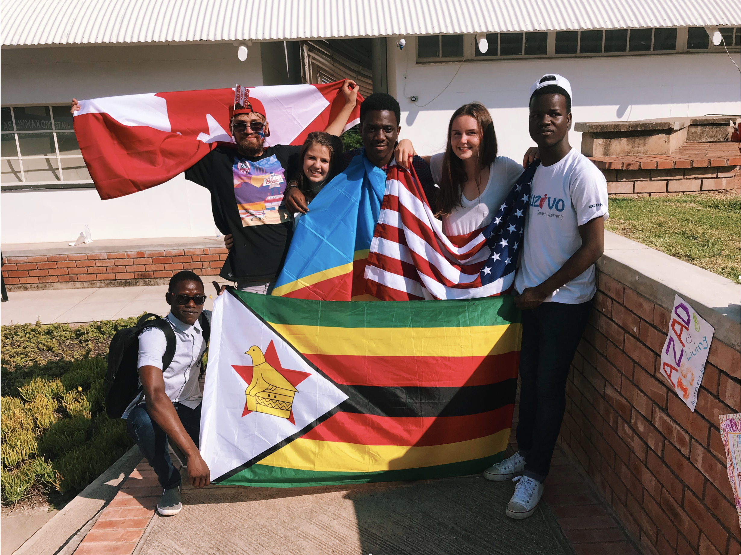On UWC day! (From left to right: Sadrin from Zimbabwe, James from USA, Abbey from Canada, Elie from the Democratic Republic of Congo, Emma (me) from Norway and USA, Overpower from Zimbabwe.)
