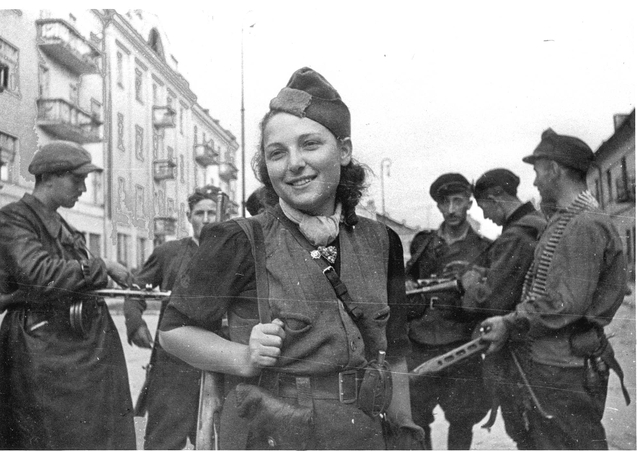 """Vilna, Poland, The partisan Rachel Rudinsky with a group of armed partisans during the liberation of the city, 1944."" Collection of Yad Vashem Photo Archive [Archival Signature 3271/13]."