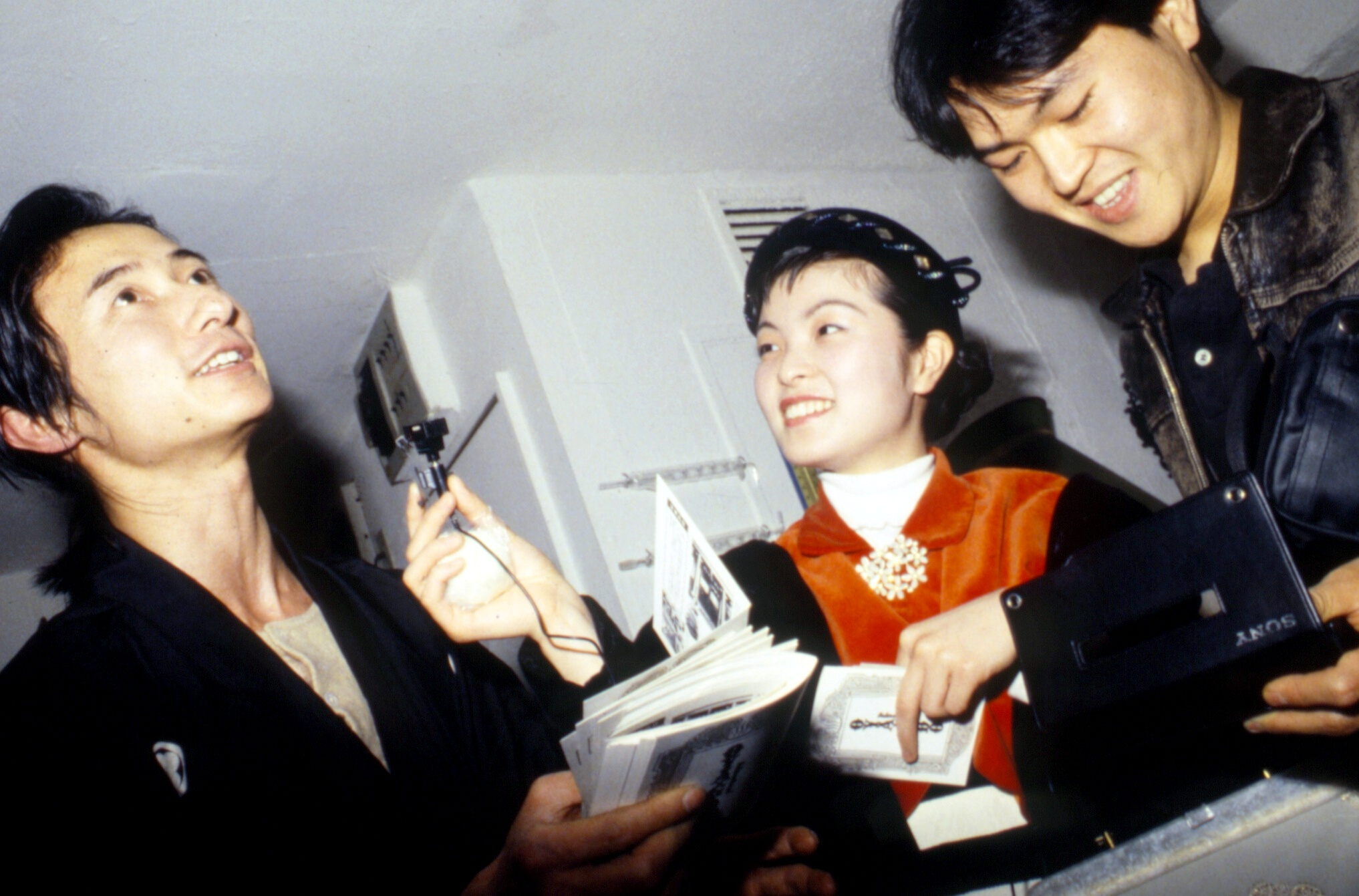 Numata Genqui (left) interviewed at gallery reception, Tokyo ca. 1988