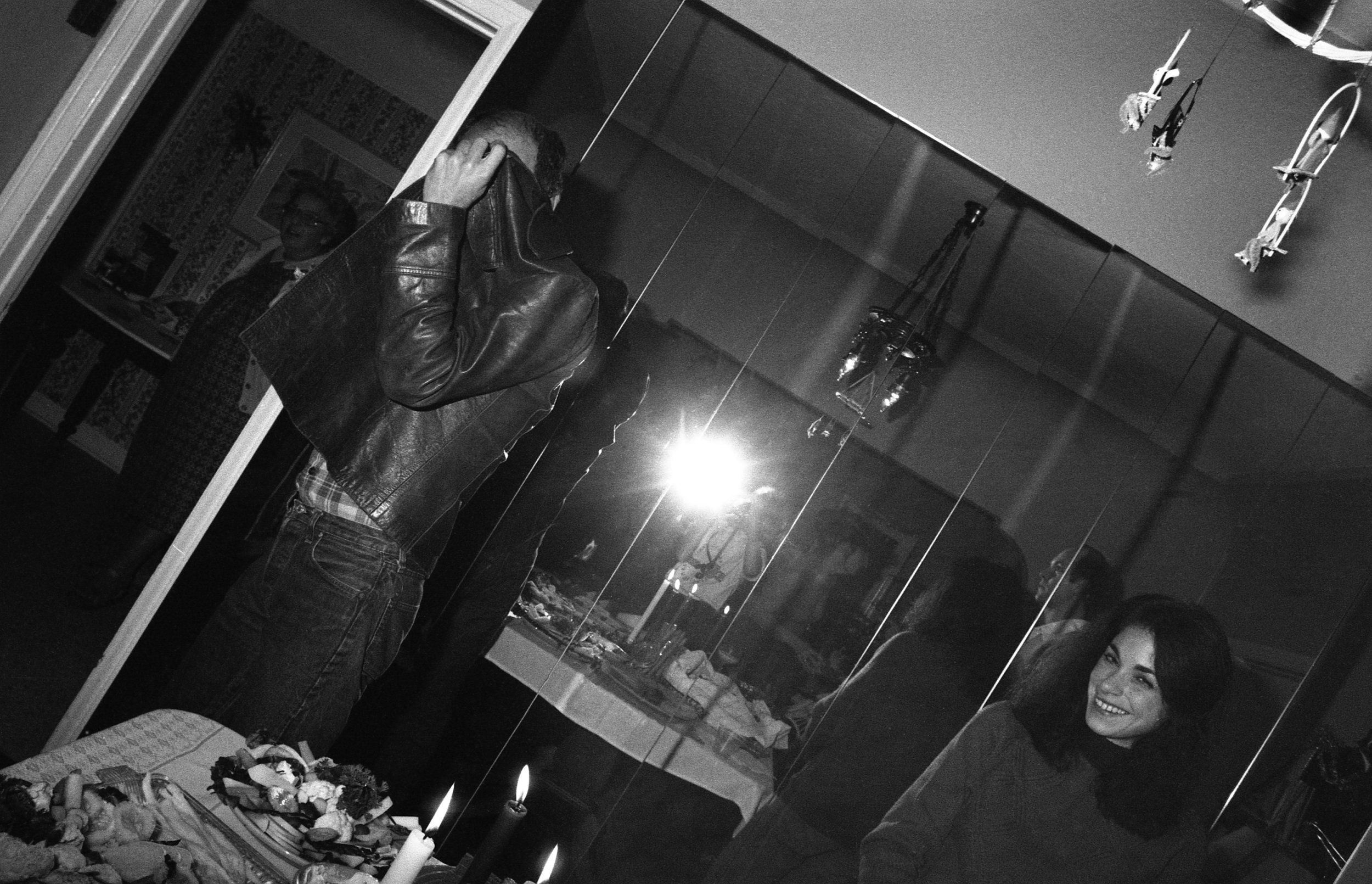 Los Angeles, December, 1981. Left to right: Sophie Youdelman, Randall Mason, Douglas Oliver (reflected in mirror), unknown woman.
